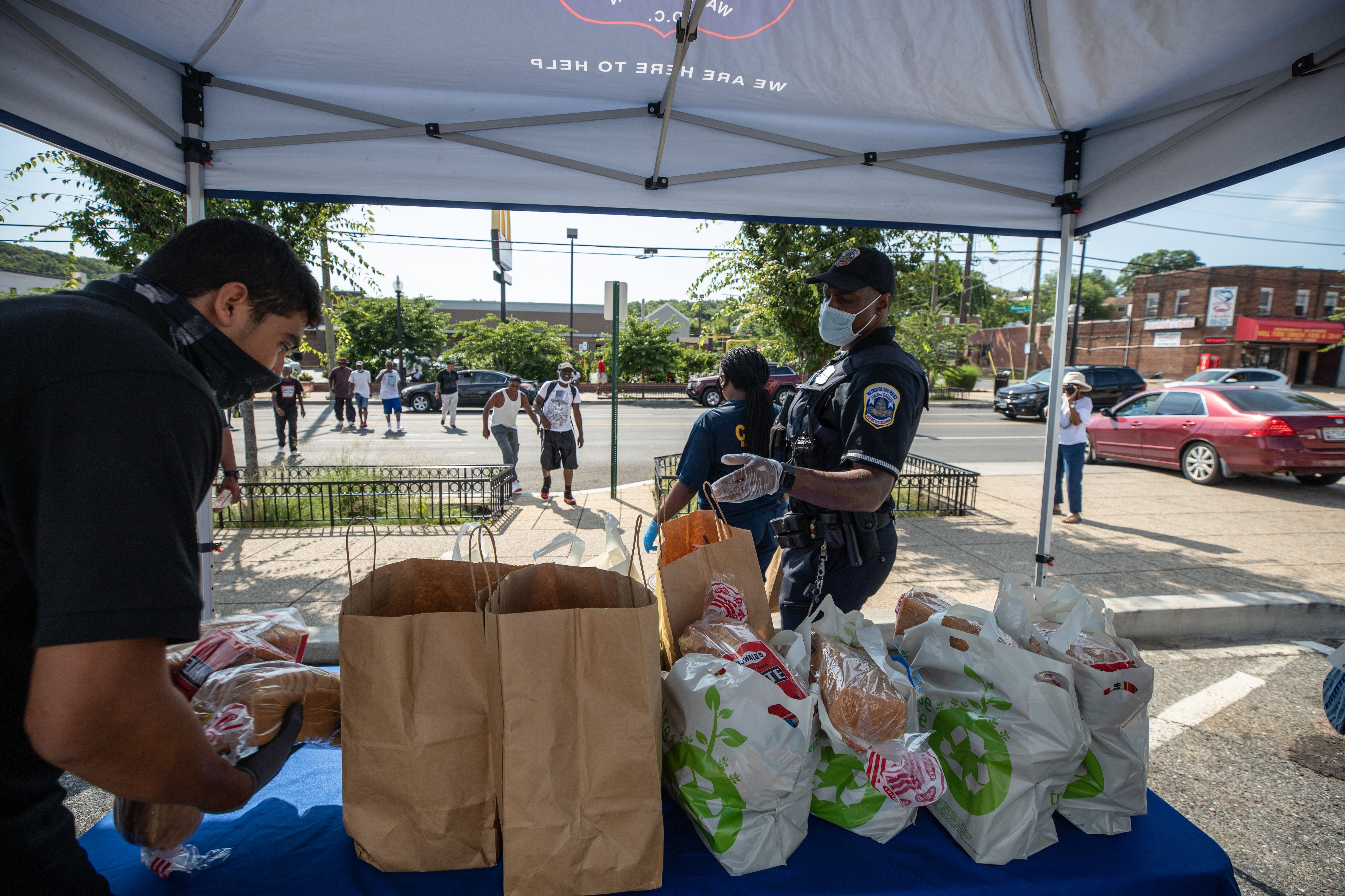 D.C. Metro Police Officers pass out grocery bags to people in D.C.'s Sixth District. (Photo: Kaylee C. Greenlee - Daily Caller News Foundation)