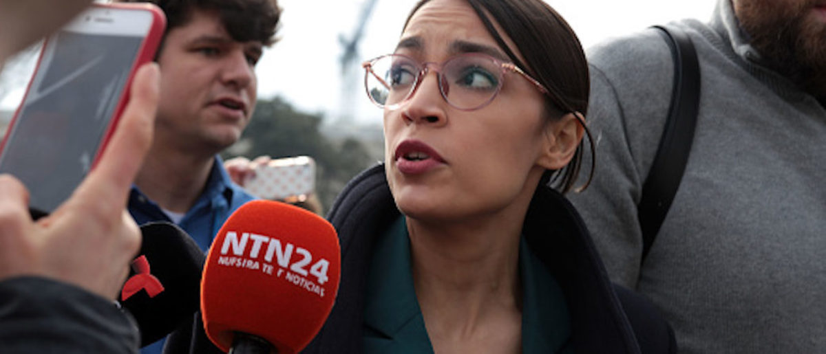 "WASHINGTON, DC - FEBRUARY 07: Followed by members of the media, U.S. Rep. Alexandria Ocasio-Cortez (D-NY) leaves a news conference at the East Front of the U.S. Capitol February 7, 2019 in Washington, DC. The House Democrat freshmen held a news conference to call on Congress ""to cut funding for President Trump's deportation force."" (Photo by Alex Wong/Getty Images)"