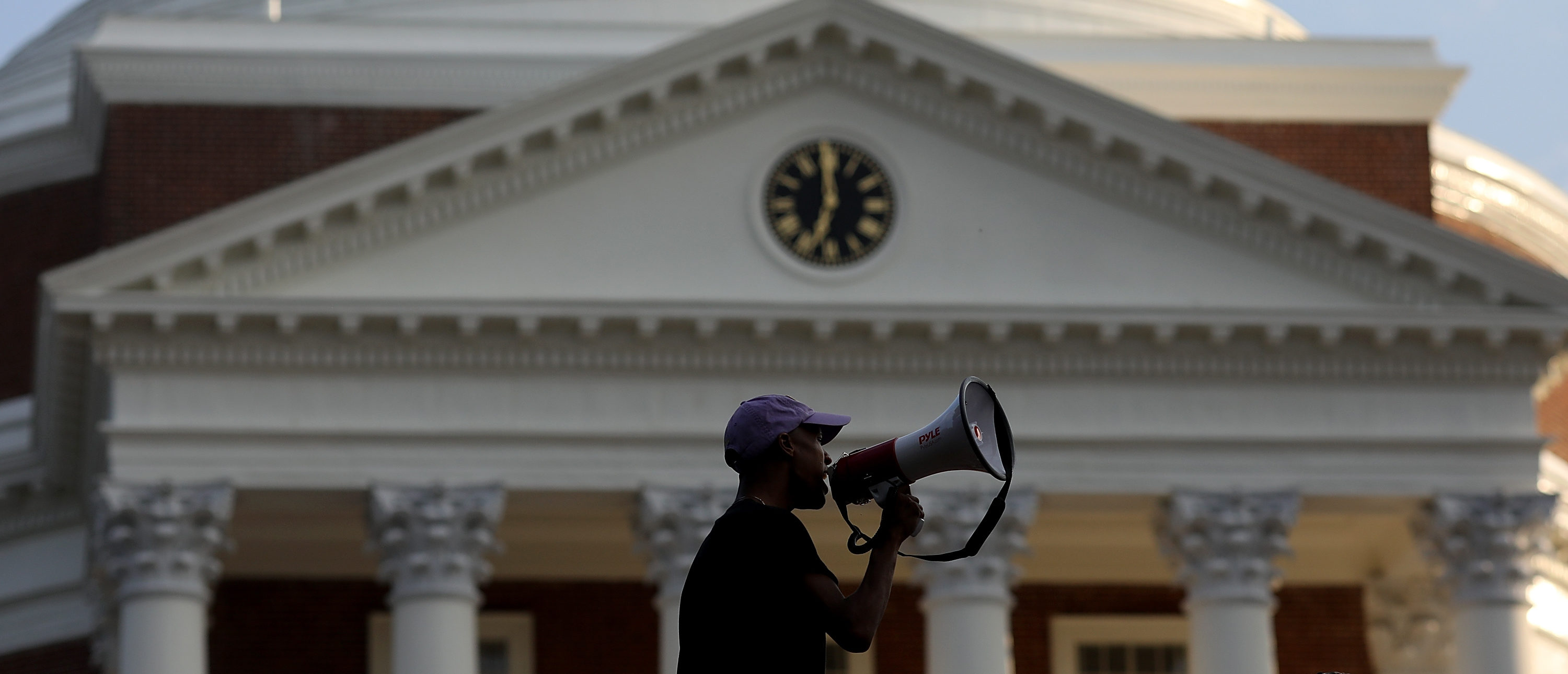 CHARLOTTESVILLE, VA - AUGUST 11: Protesters with the group Students Act Against White Supremacy speak on the campus of the University of Virginia during an event marking the one year anniversary of a deadly clash between white supremacists and counter protesters August 11, 2018 in Charlottesville, Virginia. Charlottesville has been declared in a state of emergency by Virginia Gov. Ralph Northam as the city braces for the one year anniversary of the deadly clash between white supremacist forces and counter protesters over the potential removal of Confederate statues of Robert E. Lee and Stonewall Jackson. A ÒUnite the RightÓ rally featuring some of the same groups is planned for tomorrow in Washington, DC. (Photo by Win McNamee/Getty Images)