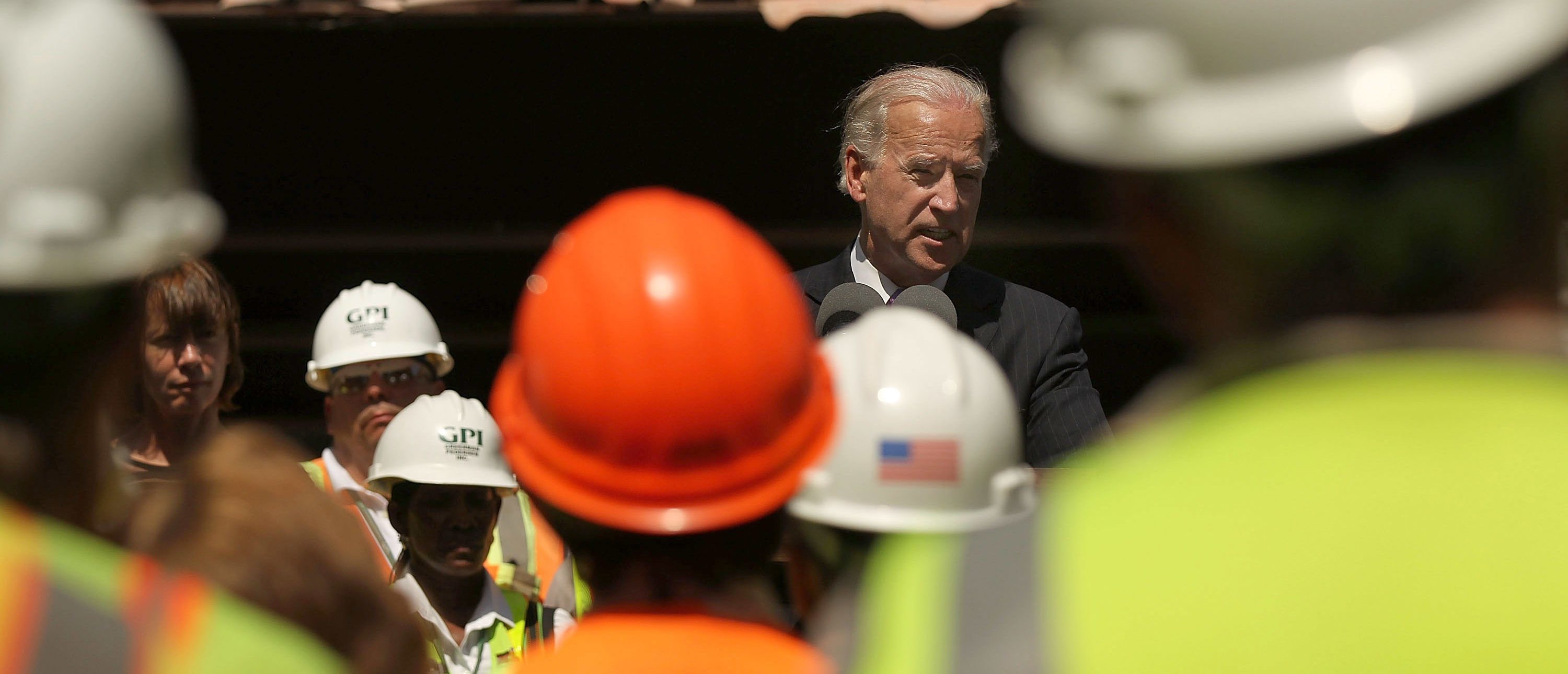 NEW YORK - JUNE 02: Vice President Joe Biden speaks to construction workers under the peeling paint of the Brooklyn Bridge at an event marking the beginning of a Brooklyn Bridge renovation project which is partly funded by money from the federal economic recovery act on June 2, 2010 in New York, New York. The renovation and maintenance project, which is set for completion in 2014, will cost roughly $500 million and will include repainting parts of the iconic bridge and working to improve traffic flow. (Photo by Spencer Platt/Getty Images)