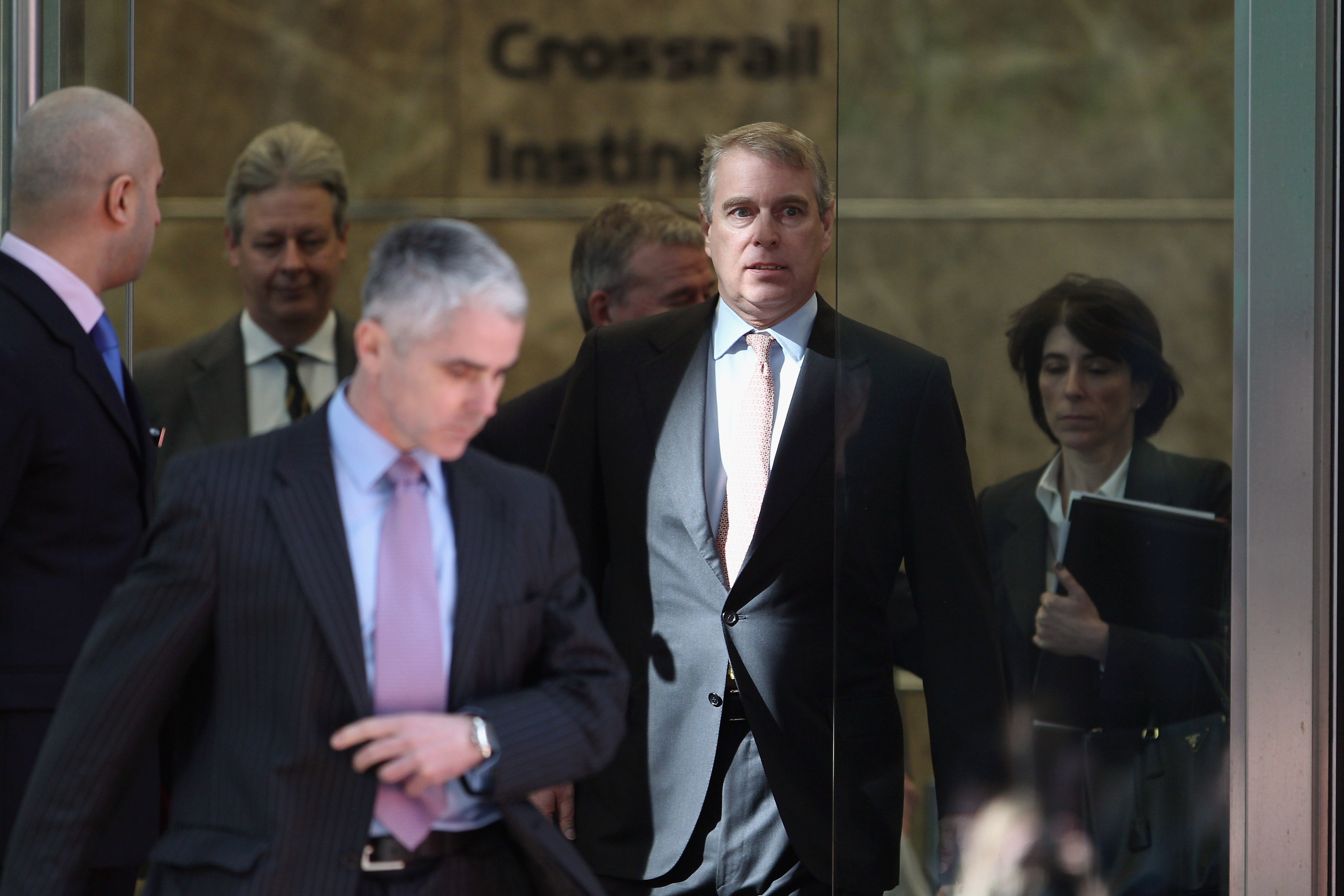 Prince Andrew, Duke of York (2nd R) leaves the headquarters of Crossrail at Canary Wharf on March 7, 2011 in London, England. Prince Andrew is under increasing pressure after a series of damaging revelations about him surfaced, including criticism over his friendship with convicted sex offender Jeffrey Epstein, an American financier. (Photo by Dan Kitwood/Getty Images)