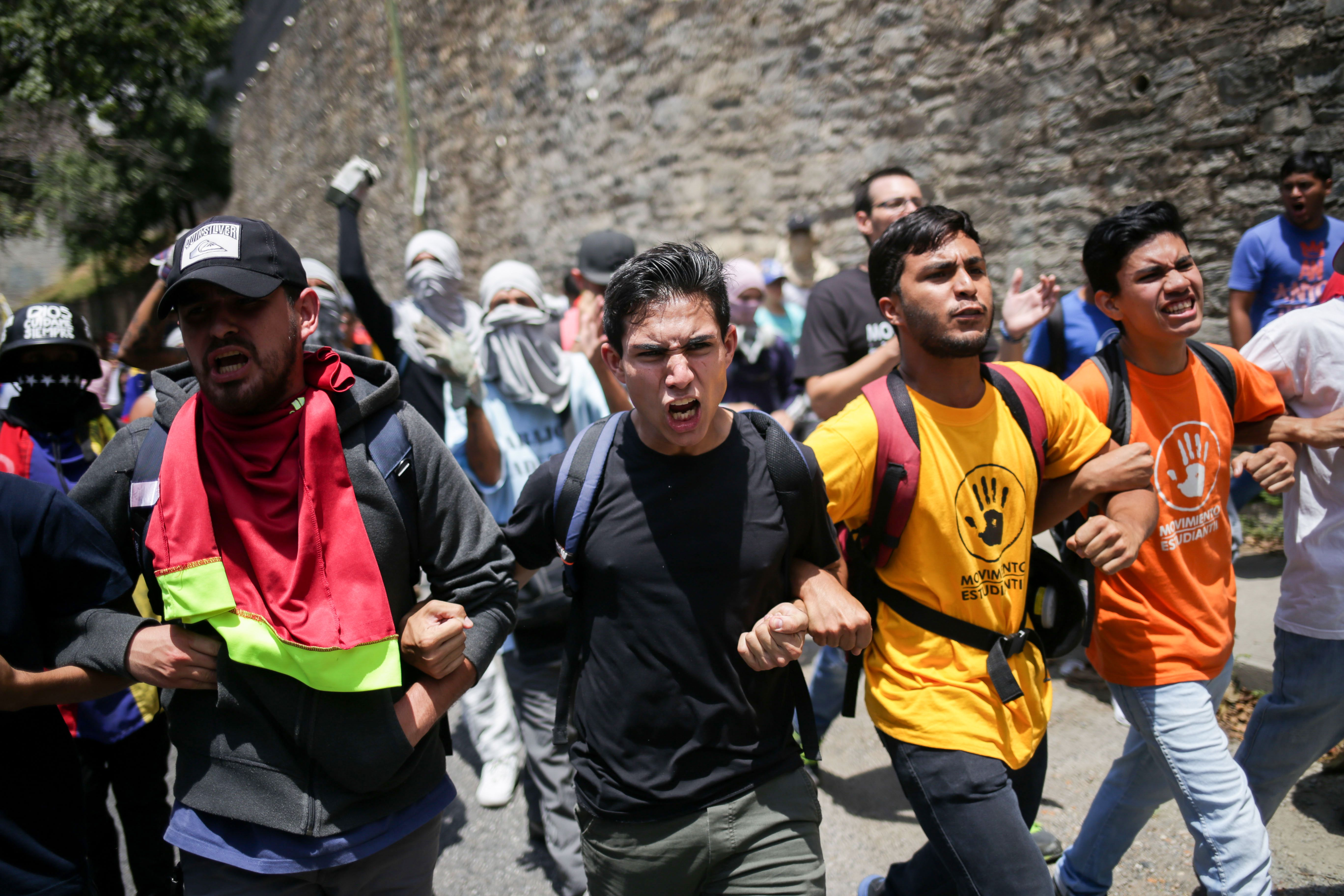 Supporters of Venezuelan opposition leader and self-proclaimed acting president Juan Guaido demonstrate in Caracas on March 9, 2019. - Venezuelan riot police blocked protesters on Saturday as thousands of people took to the streets amid rising tensions between opposition leader Juan Guaido and President Nicolas Maduro. (CRISTIAN HERNANDEZ/AFP via Getty Images)