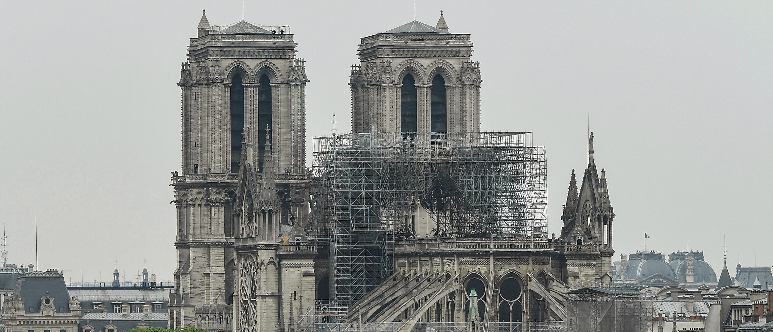 TOPSHOT - A picture taken on April 16, 2019 shows Notre-Dame-de-Paris in the aftermath of a fire that devastated the cathedral. - Paris was struck in its very heart as flames devoured the roof of Notre-Dame, on April 15, 2019, the medieval cathedral made famous by Victor Hugo, its two massive towers flanked with gargoyles instantly recognisable even by people who have never visited the city. (Photo by BERTRAND GUAY / AFP) (Photo credit should read BERTRAND GUAY/AFP via Getty Images)