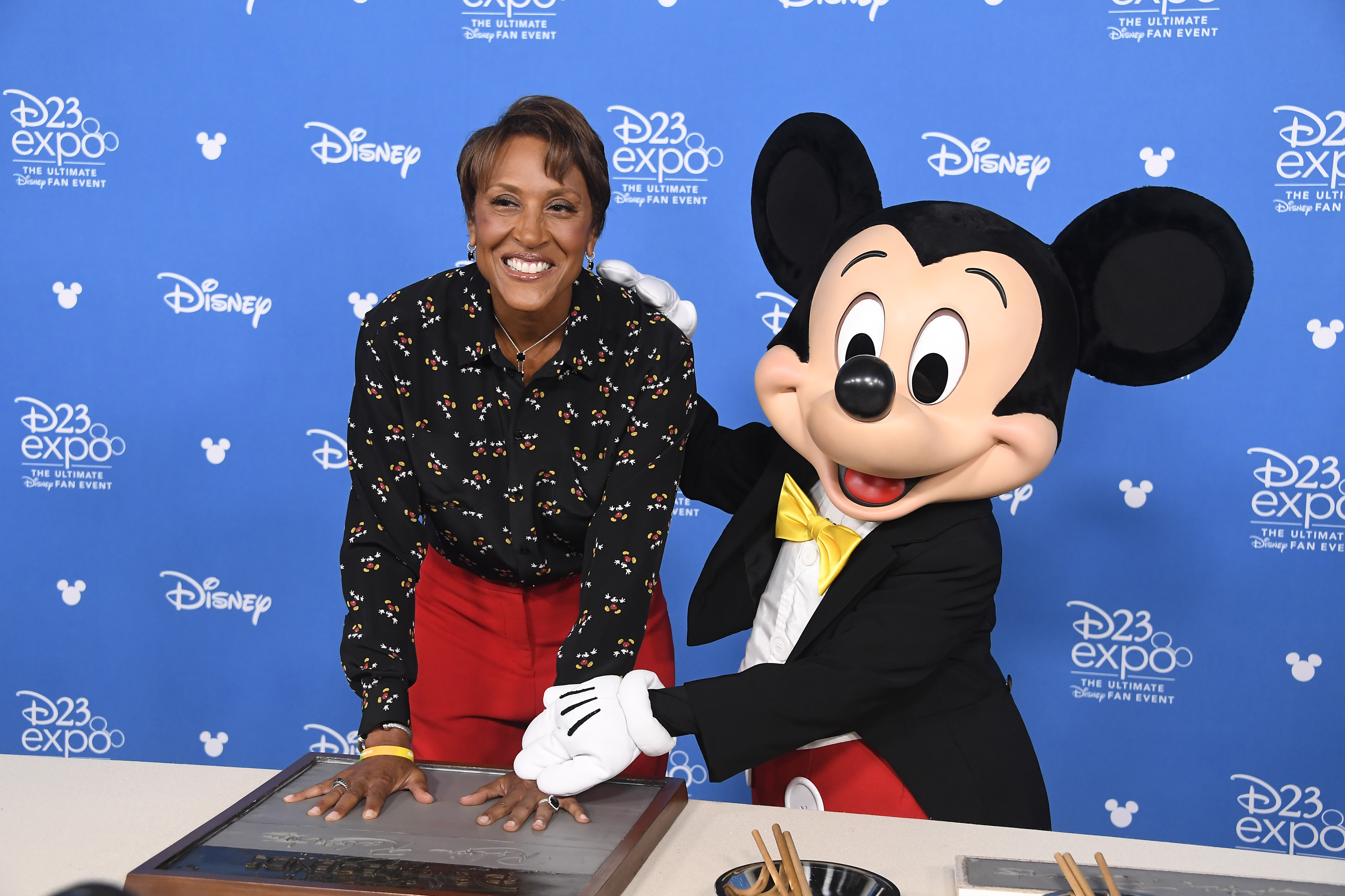 Robin Roberts and Micky Mouse attend a 2019 Disney event in California. (Photo: Frazer Harrison/Getty Images)