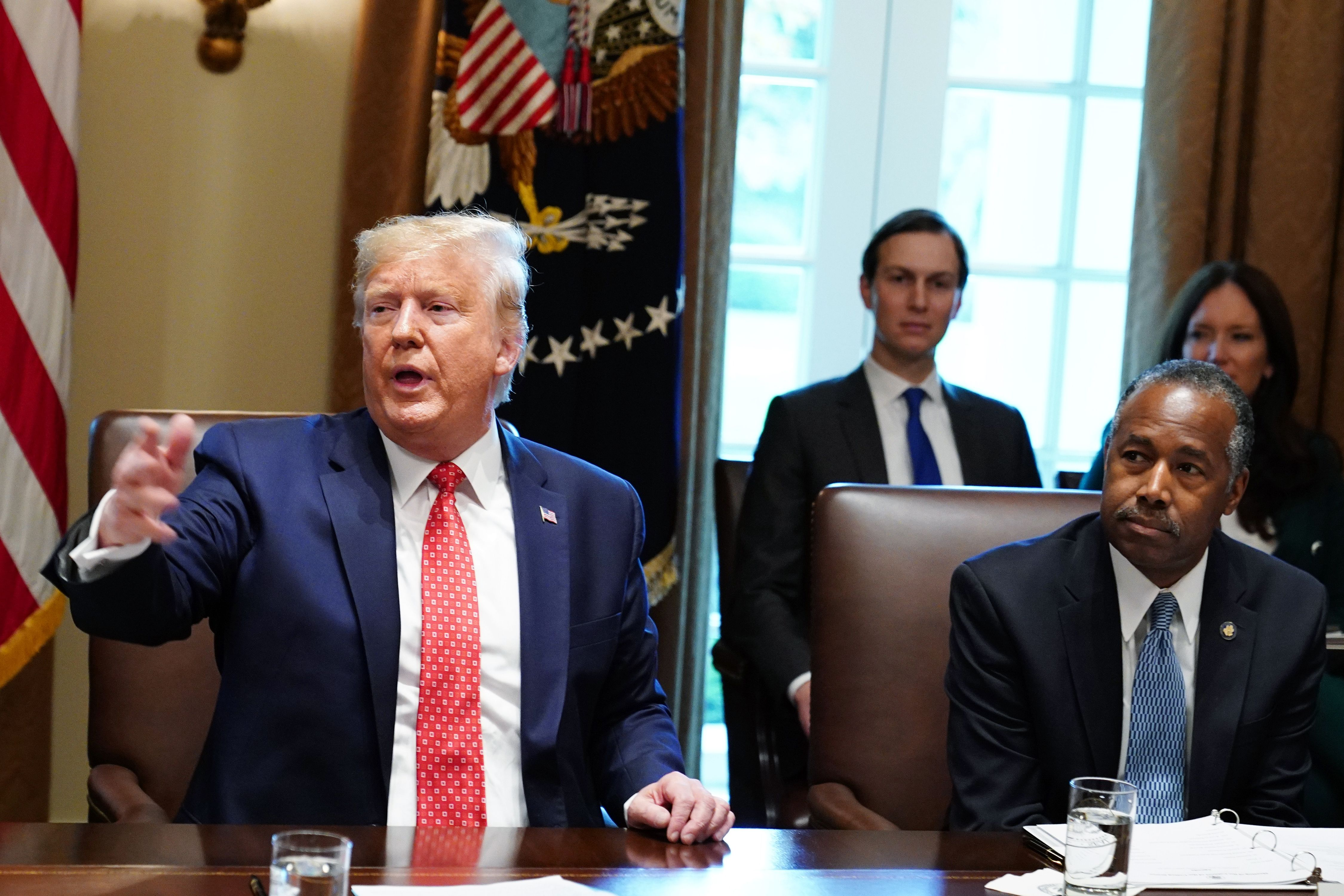 US President Donald Trump takes part in a cabinet meeting in the Cabinet Room of the White House in Washington, DC on November 19, 2019 as Ben Carson, Secretary of Housing and Urban Development looks on. (Photo by MANDEL NGAN/AFP via Getty Images)