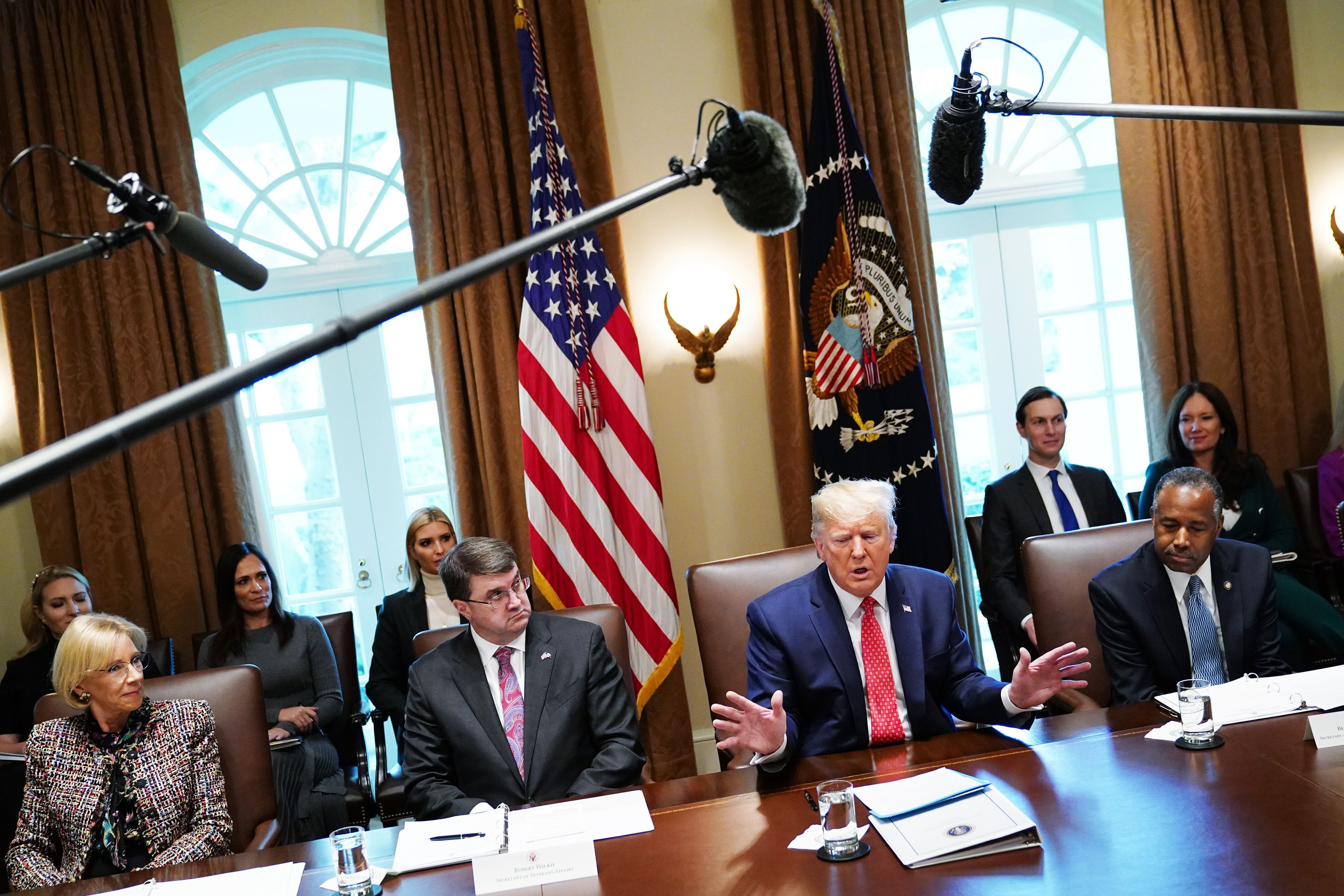US President Donald Trump speak during a cabinet meeting in the Cabinet Room of the White House in Washington, DC on November 19, 2019, as (L-R) Education Secretary Betsy DeVos, Veterans Affairs Secretary Robert Wilkie, and Secretary of Housing and Urban Development Ben Carson listen. (Photo by MANDEL NGAN/AFP via Getty Images)