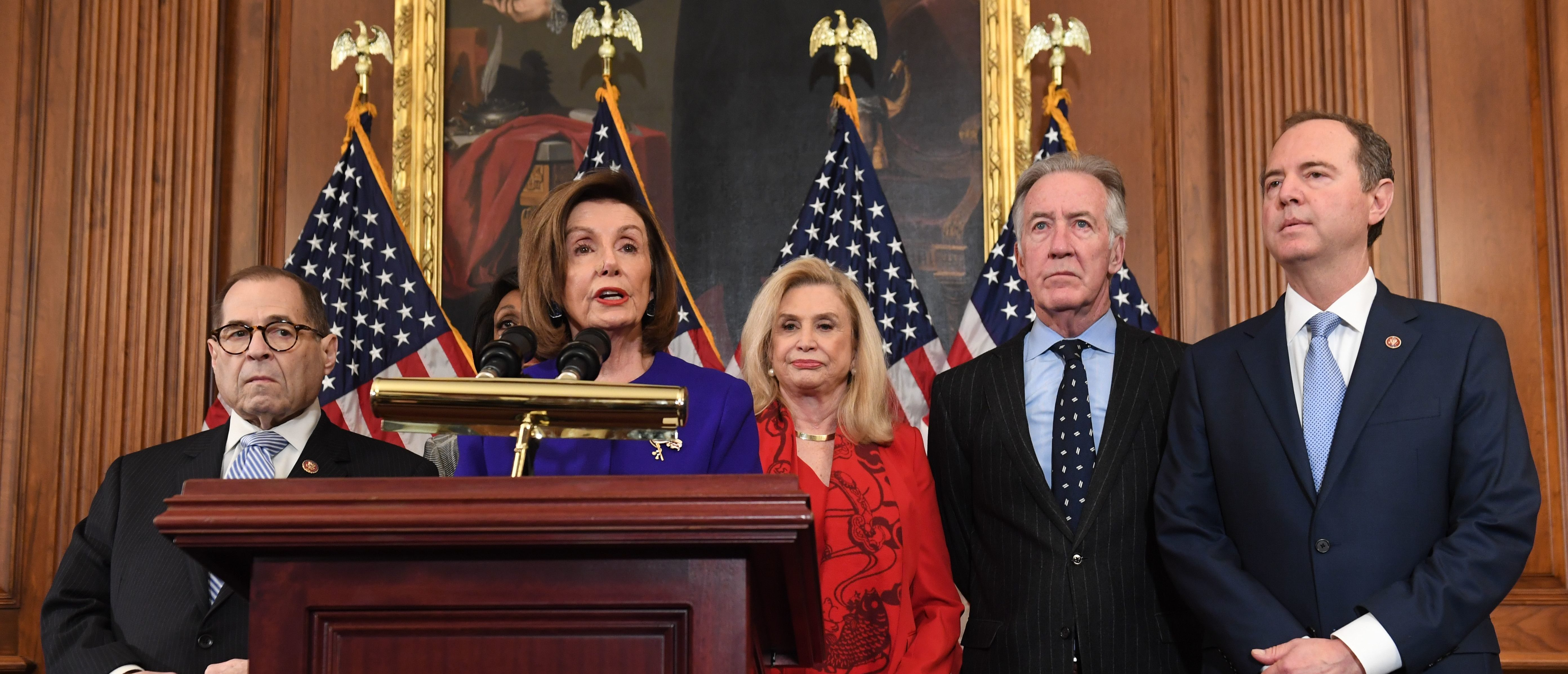 Speaker of the House Nancy Pelosi (C), flanked by House Permanent Select Committee on Intelligence Chairman Adam Schiff (R)(D-CA), House Judiciary Chairman Jerry Nadler (L) (D-NY), House Foreign Affairs Committee Chairman Eliot Engel (2ndR) (D-NY), House Financial Services Committee Chairwoman Maxine Waters (background)(D-CA), and House Committee on Oversight and Reform Chairwoman Carolyn Maloney (2nd R) (D-NY), speaks as Democrats announced articles of impeachment against US President Donald Trump during a press conference at the US Capitol in Washington, DC, December 10, 2019 listing abuse of power and obstruction of Congress. (Photo by SAUL LOEB / AFP) (Photo by SAUL LOEB/AFP via Getty Images)