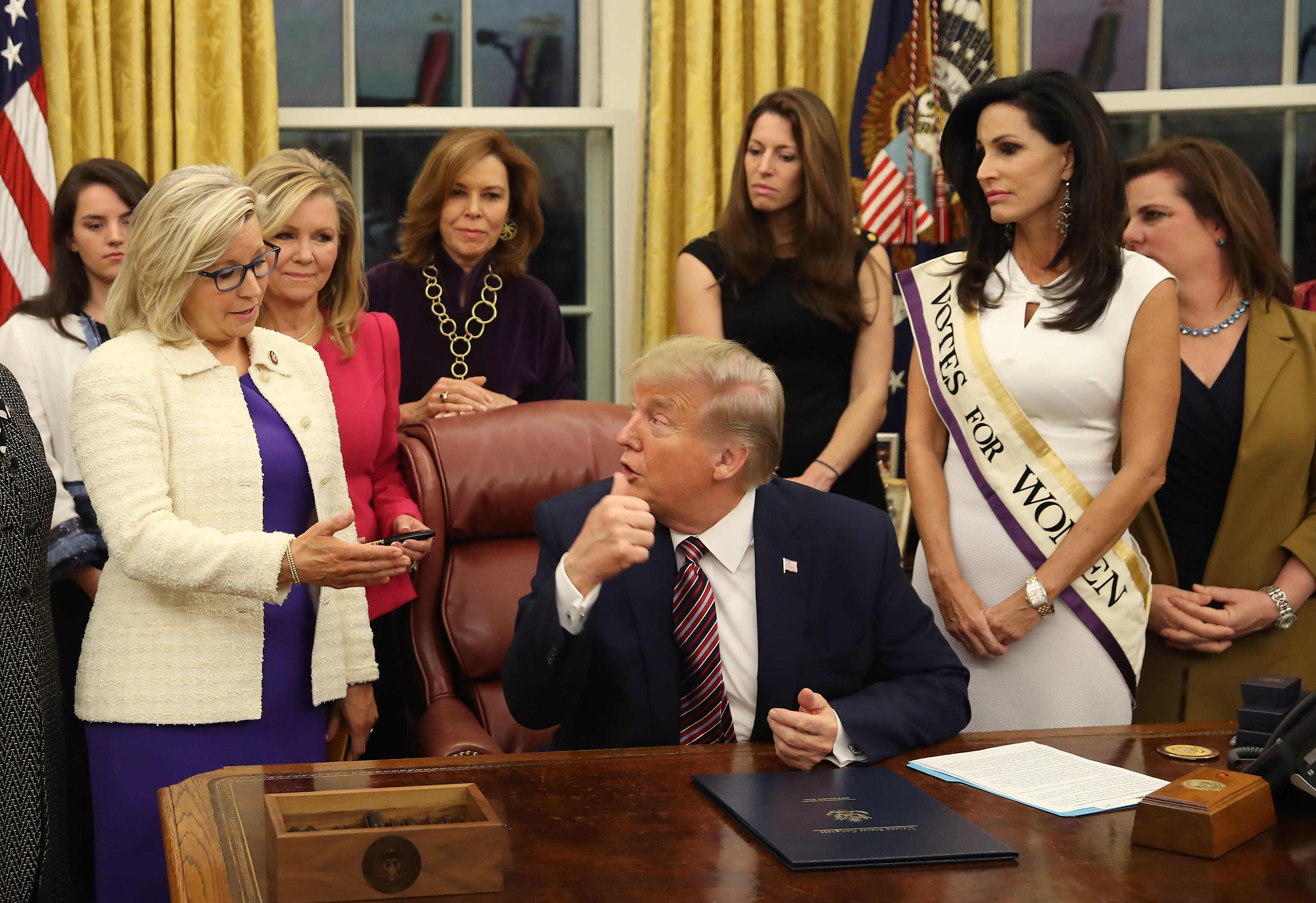 WASHINGTON, DC - NOVEMBER 25: U.S. President Donald Trump talks with Rep. Liz Cheney (R-WY) (L) after signing H.R. 2423, the Women's Suffrage Centennial Commemorative Coin Act, in the Oval Office at the White House on November 25, 2019 in Washington, DC. (Photo by Mark Wilson/Getty Images)