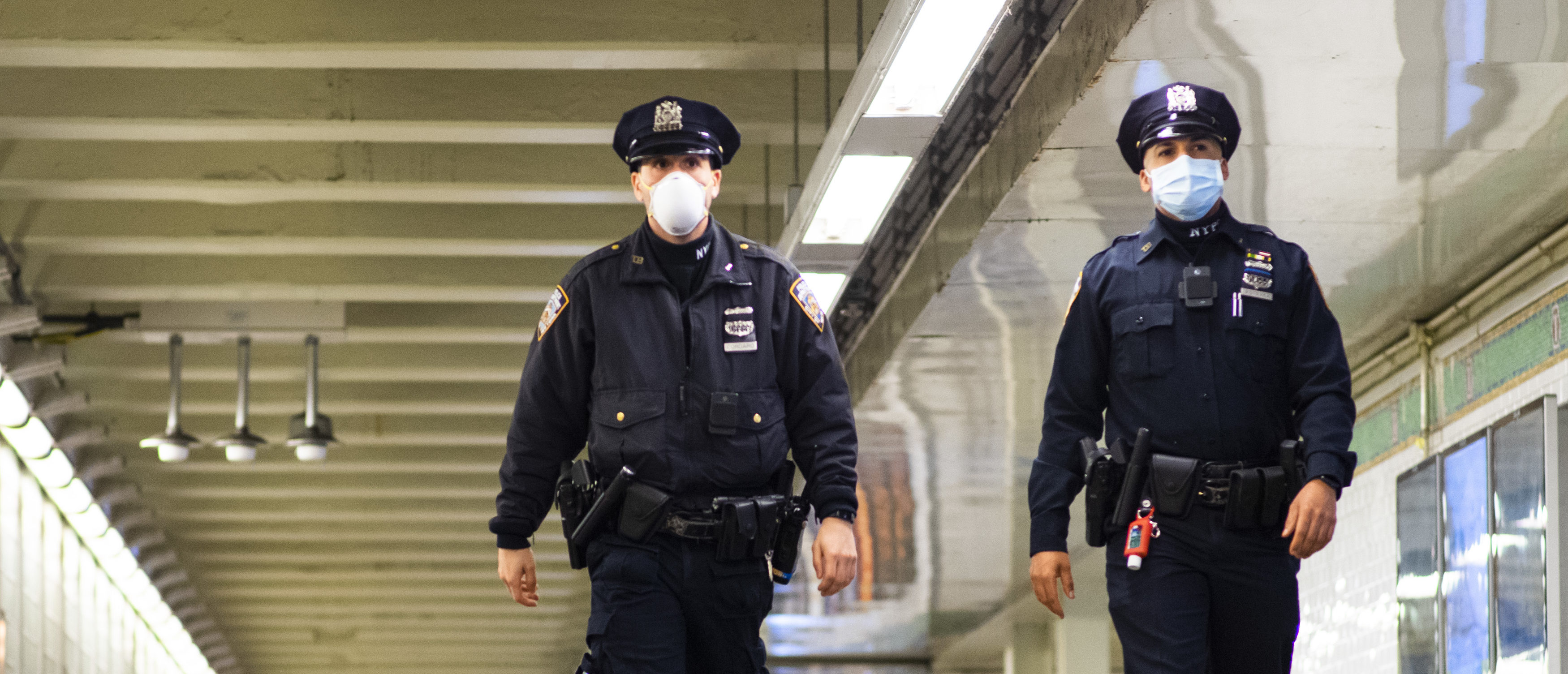 NYPD officers patrol inside Times Square station as the New York City subway system (Eduardo Munoz Alvarez/Getty Images)