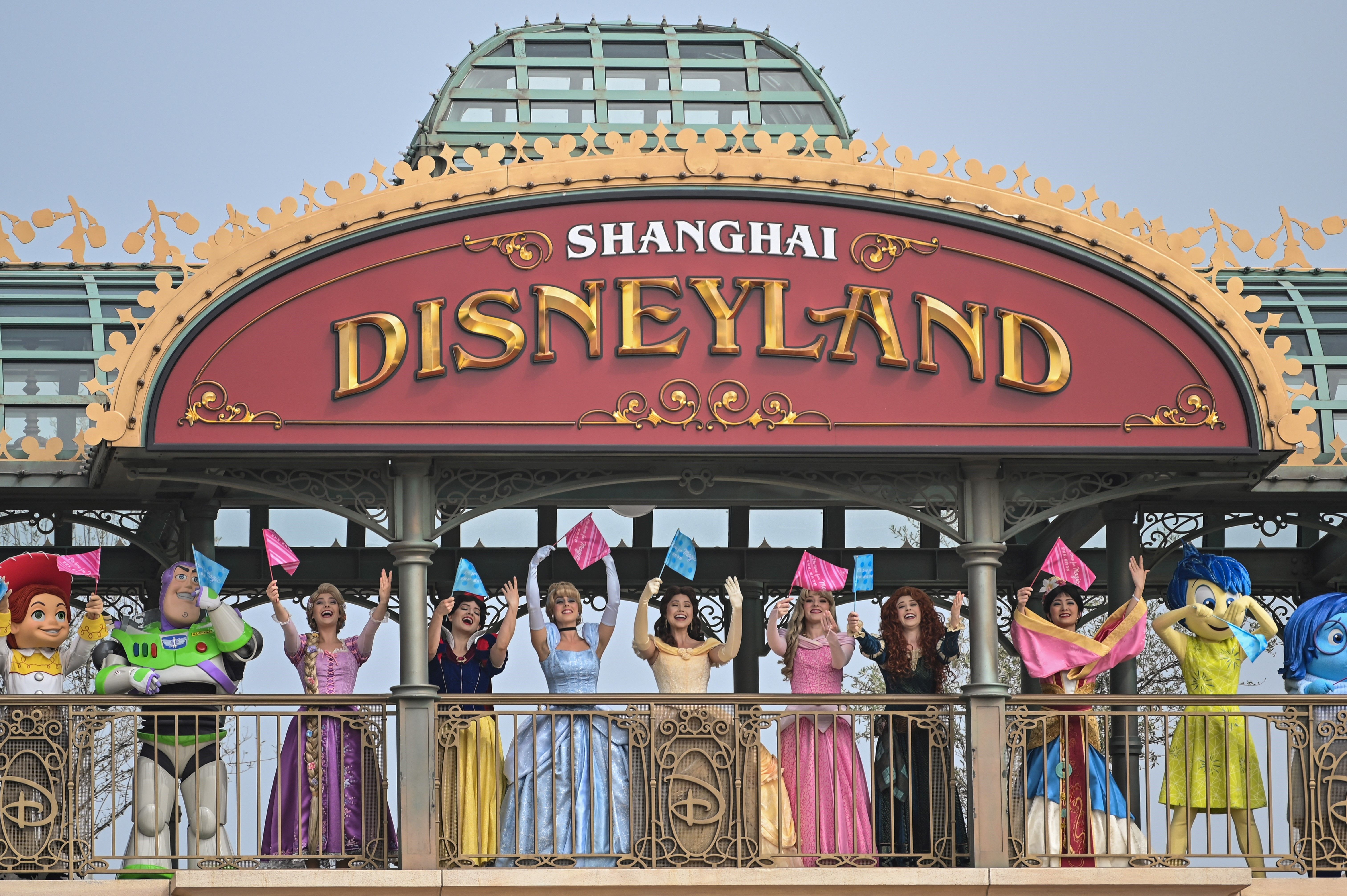 Performers dressed as Disney characters are seen during the reopening of the Disneyland amusement park in Shanghai on May 11, 2020. - Disneyland Shanghai reopened on May 11 to the public after being closed since January due to the COVID-19 coronavirus outbreak. (Photo by Hector RETAMAL / AFP) (Photo by HECTOR RETAMAL/AFP via Getty Images)