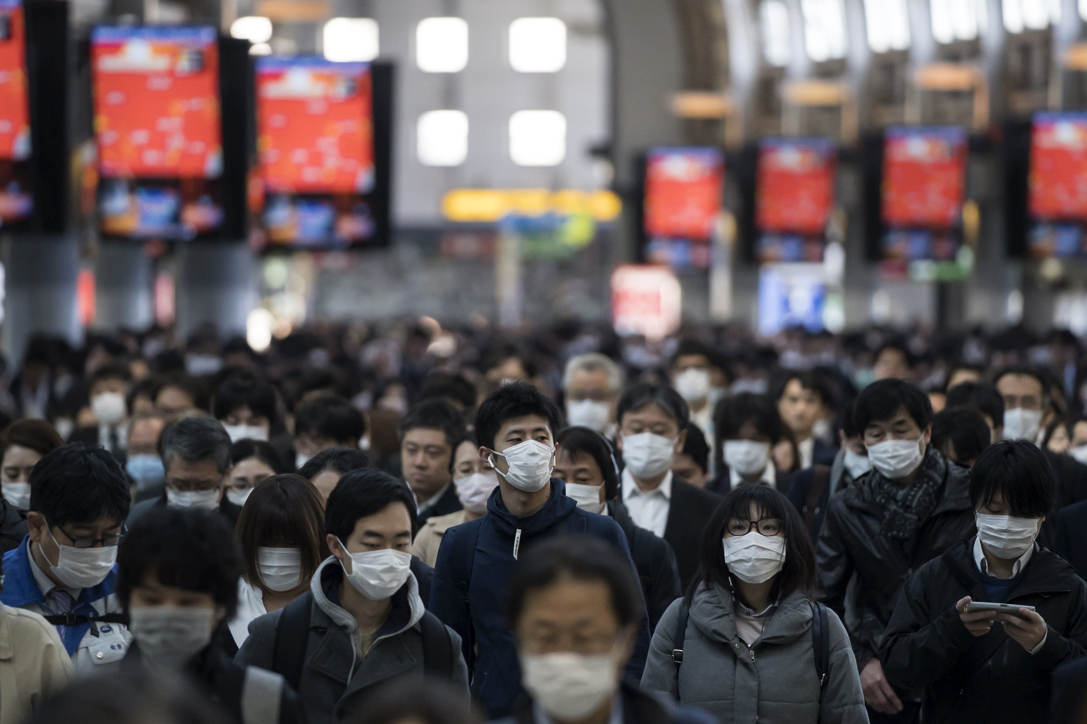 Commuters make their way to work in March, 2020 in Tokyo, Japan. (Photo: Tomohiro Ohsumi/Getty Images)