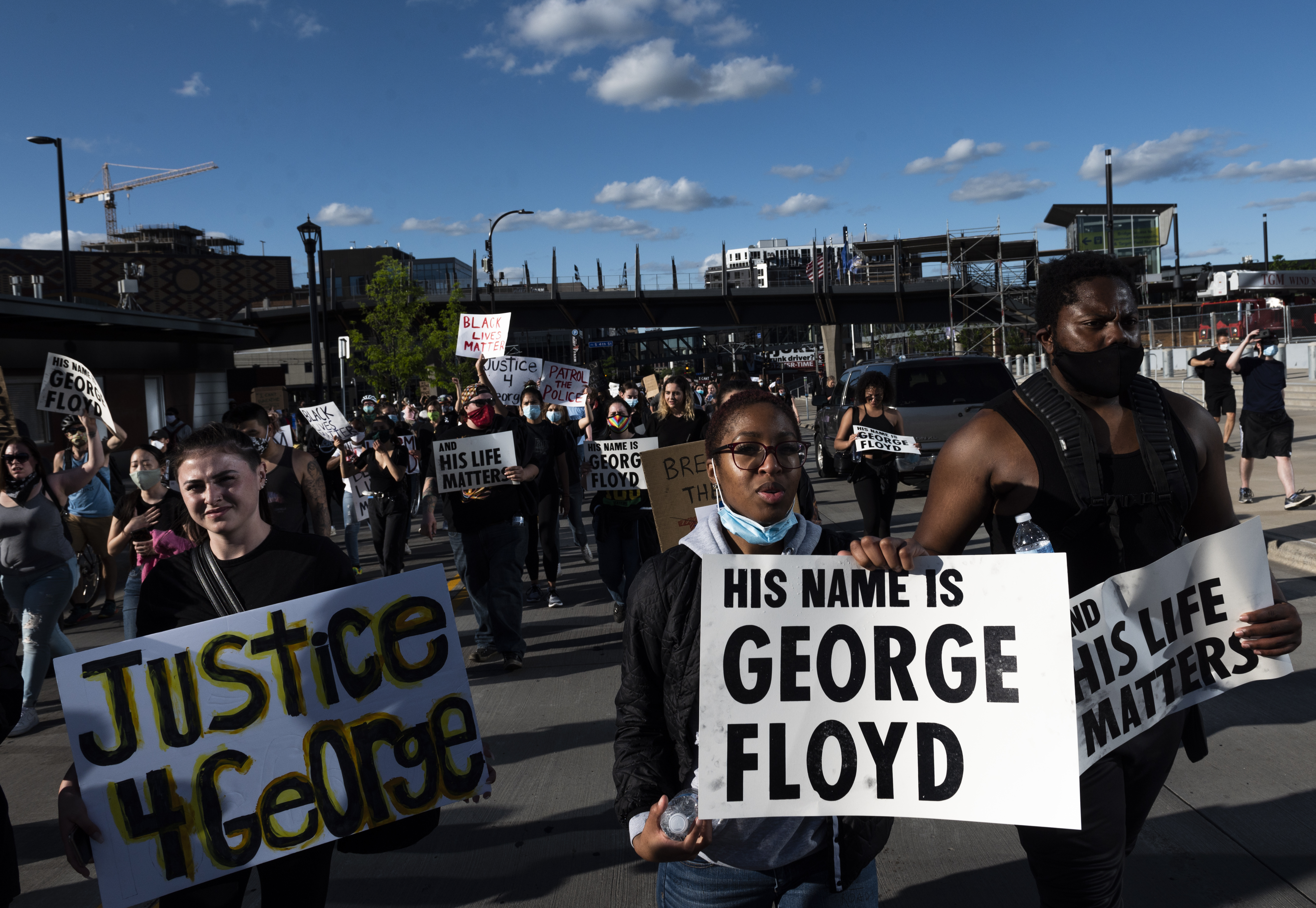 Protesters march by U.S. Bank Stadium in response to the police killing of George Floyd on May 29, 2020 in Minneapolis, Minnesota. Demonstrations and protests have been ongoing since Floyd's death in police custody on Monday. (Photo by Stephen Maturen/Getty Images)