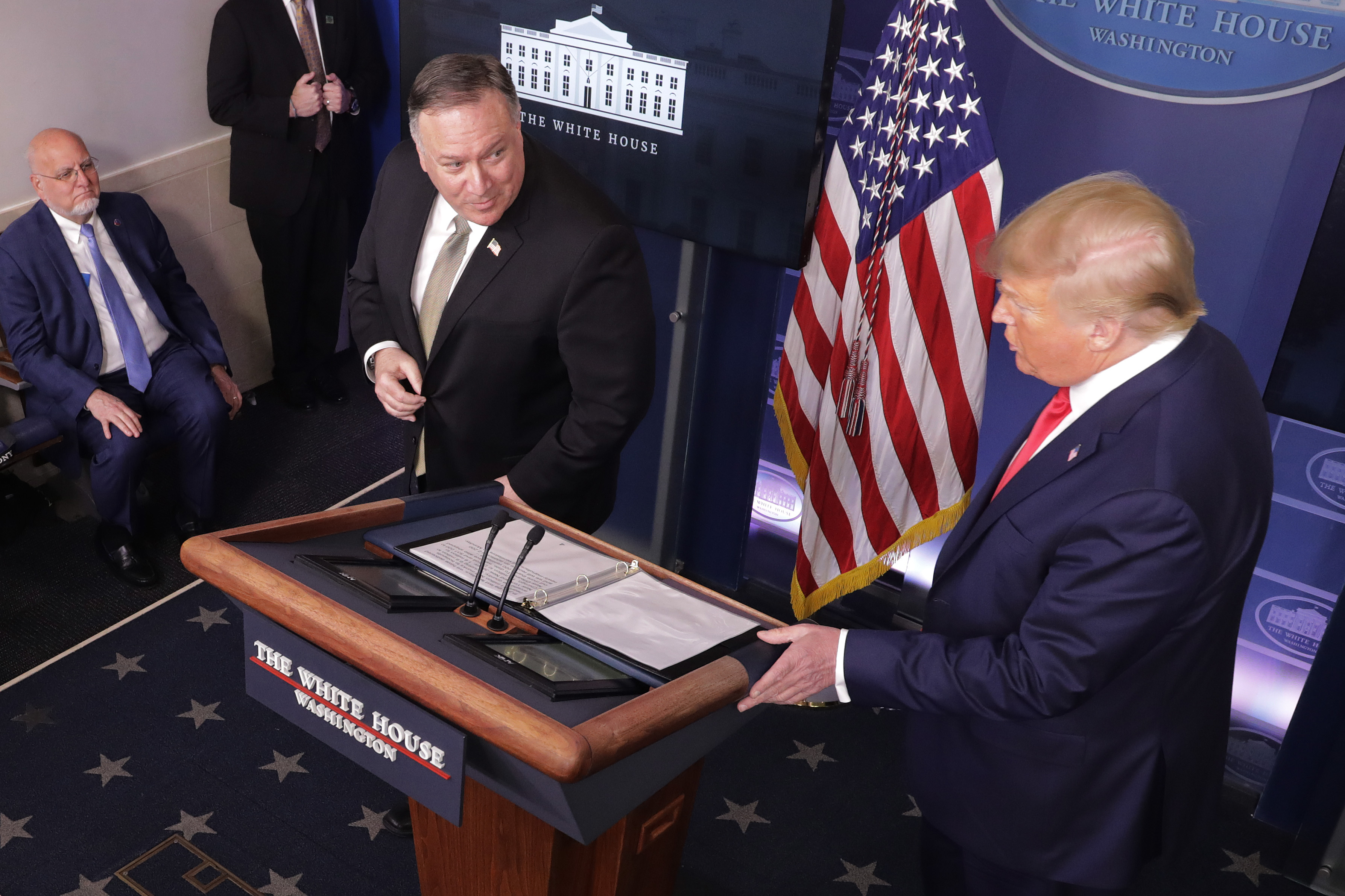 WASHINGTON, DC - APRIL 08: (L-R) Centers for Disease Control and Prevention Director Robert Redfield, Secretary of State Mike Pompeo and President Donald Trump participate in the daily coronavirus task force briefing in the Brady Press Briefing Room at the White House on April 08, 2020 in Washington, DC. President Trump vowed to hold back funding for the World Health Organization at the briefing, accusing the organization of having not been aggressive enough in confronting the virus, but later denied saying funding would be withheld, according to published reports. (Photo by Chip Somodevilla/Getty Images)