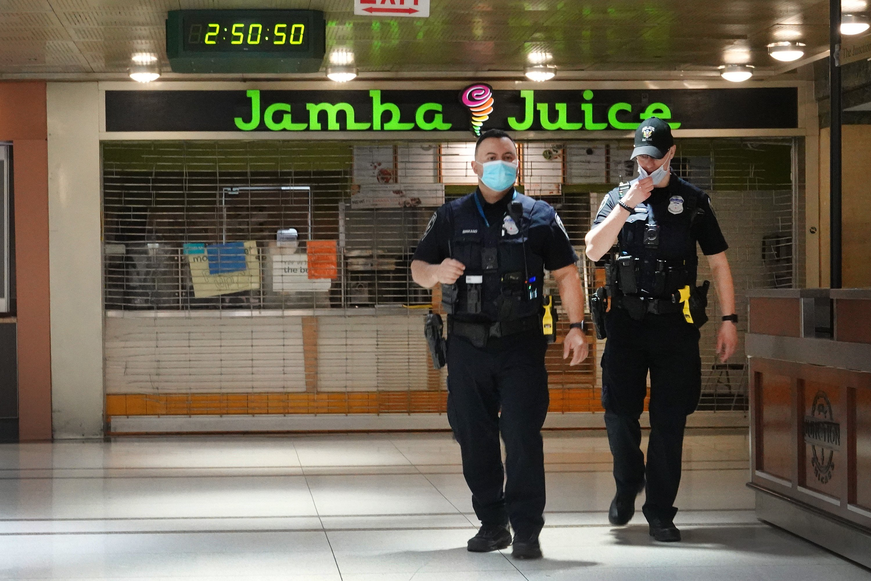 CHICAGO, ILLINOIS - APRIL 28: Amtrak police patrol the mostly-shuttered food court inside of Union Station on April 28, 2020 in Chicago, Illinois. Union Station serves Amtrak and Metra commuter train passengers riding into downtown Chicago. Amtrak has reported a 95 percent drop in ridership since the start of the COVID-19 pandemic, and Metra a 97 percent drop. (Photo by Scott Olson/Getty Images)