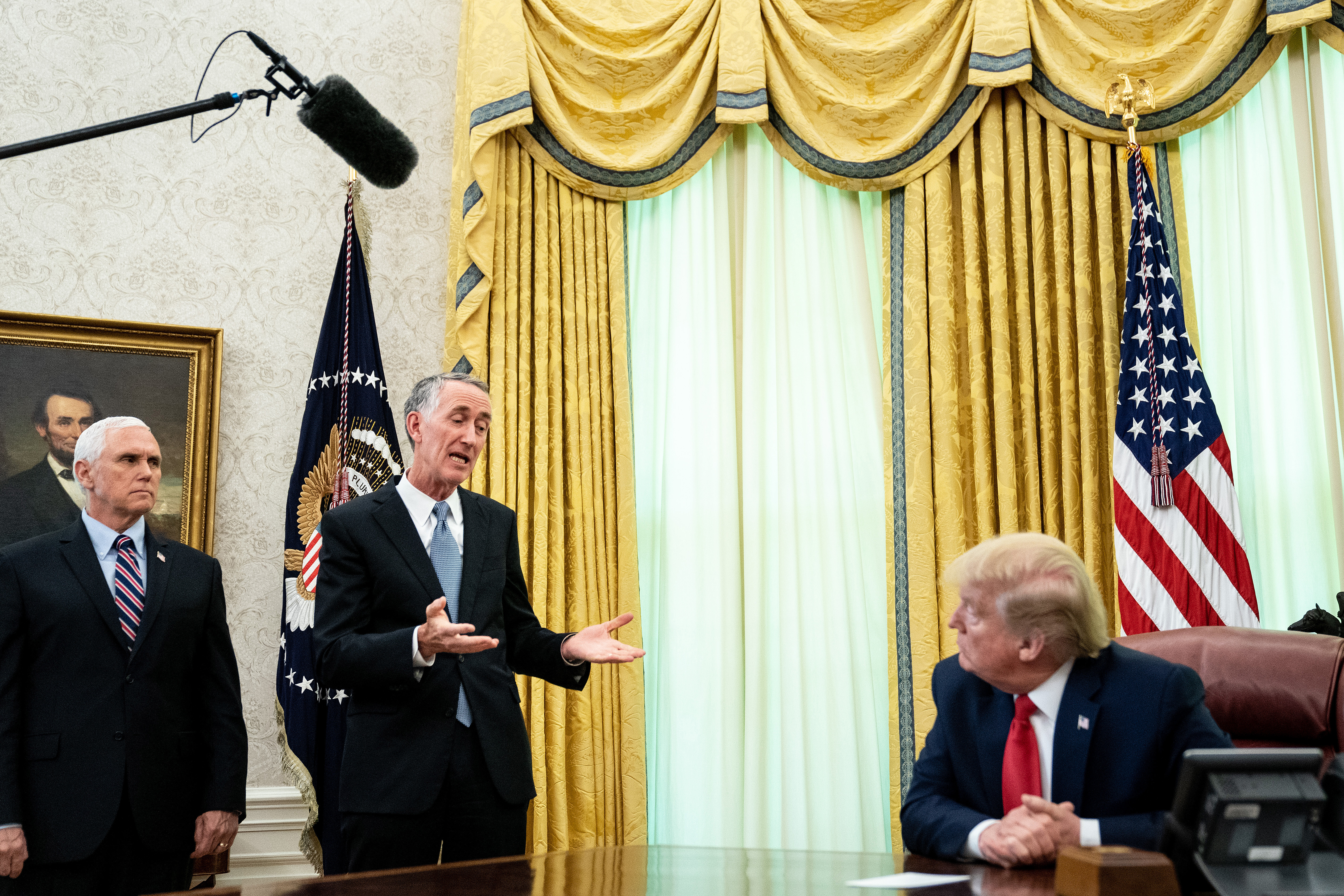 U.S. President Donald Trump is joined by Gilead Sciences Chairman and CEO Daniel O'Day and Vice President Mike Pence to announce that the Food and Drug Administration issued an emergency approval for the antiviral drug remdesivir in the Oval Office at the White House on May 1, 2020. (Photo: Erin Schaff-Pool/Getty Images)