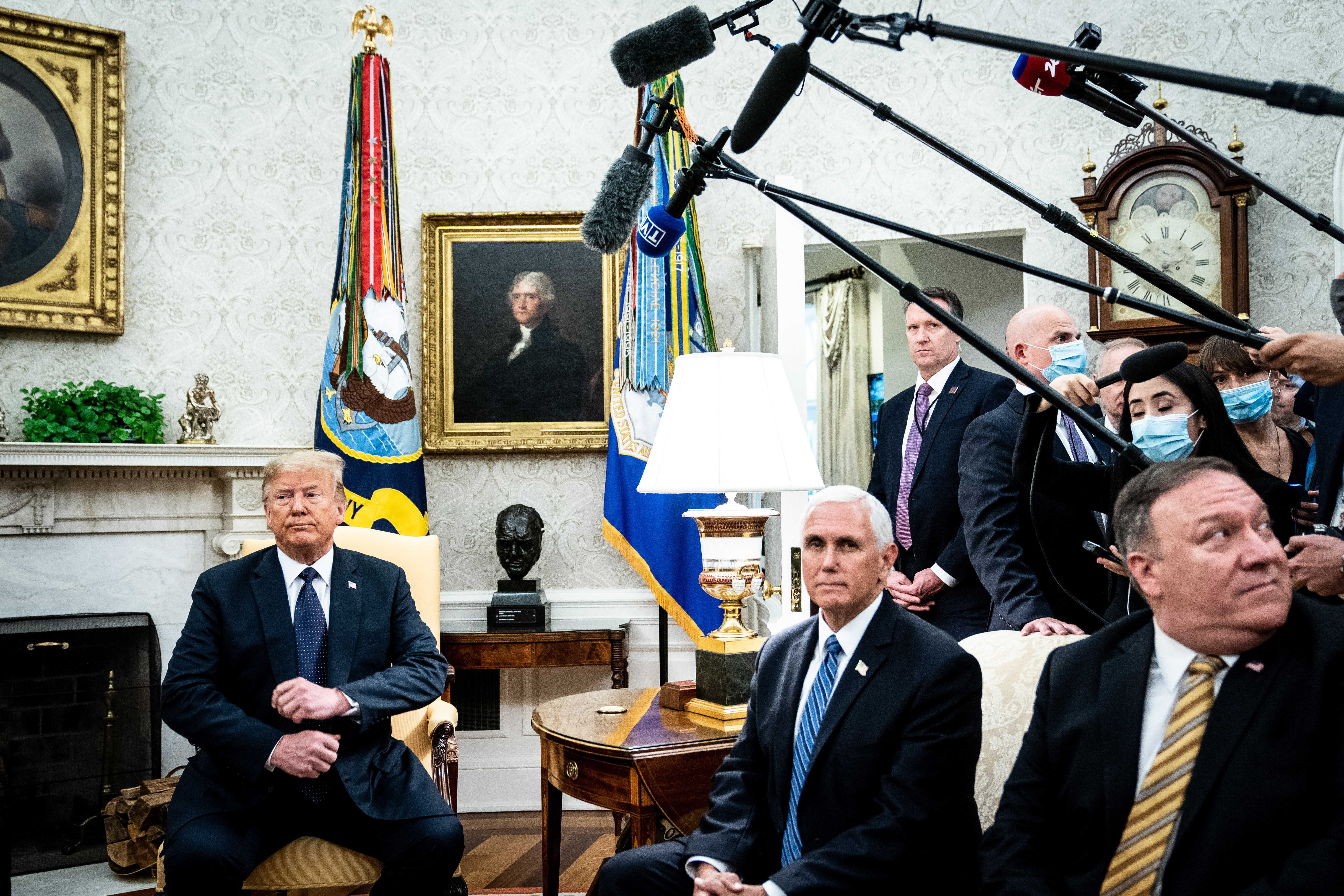 WASHINGTON, DC - JUNE 24: (L-R) U.S. President Donald Trump, Vice President Mike Pence and Secretary of State Mike Pompeo attend a meeting with Polish President Andrzej Duda in the Oval Office of the White House on June 24, 2020 in Washington, DC. Duda, who faces a tight re-election contest in four days, is Trump's first world leader visit from overseas since the coronavirus pandemic began. (Photo by Erin Schaff-Pool/Getty Images)