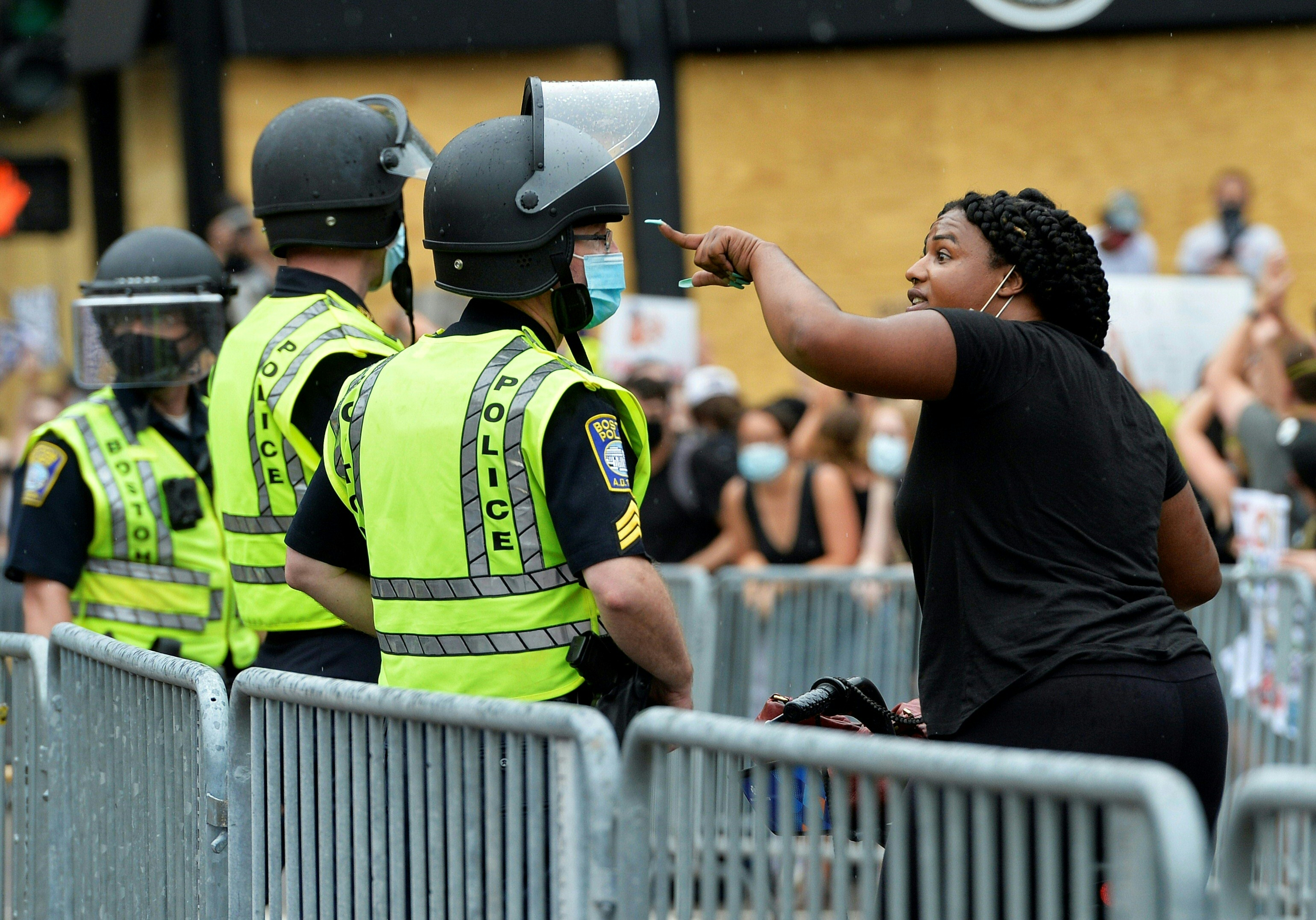 A women argues with police officers during a rally outside the Massachusetts State House in Boston on June 27, 2020. (Photo: Joseph Prezioso/AFP via Getty Images)