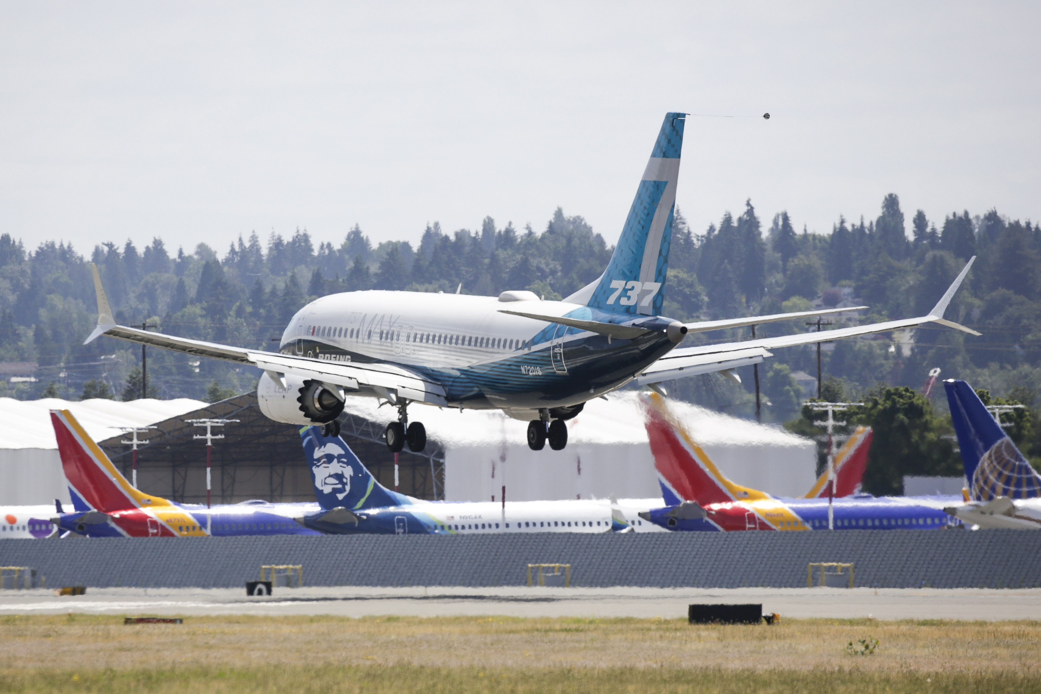 A Boeing 737 MAX jet lands near grounded 737 MAX planes following Federal Aviation Administration (FAA) test flight at Boeing Field in Seattle, Washington on June 29, 2020. (JASON REDMOND/AFP via Getty Images)