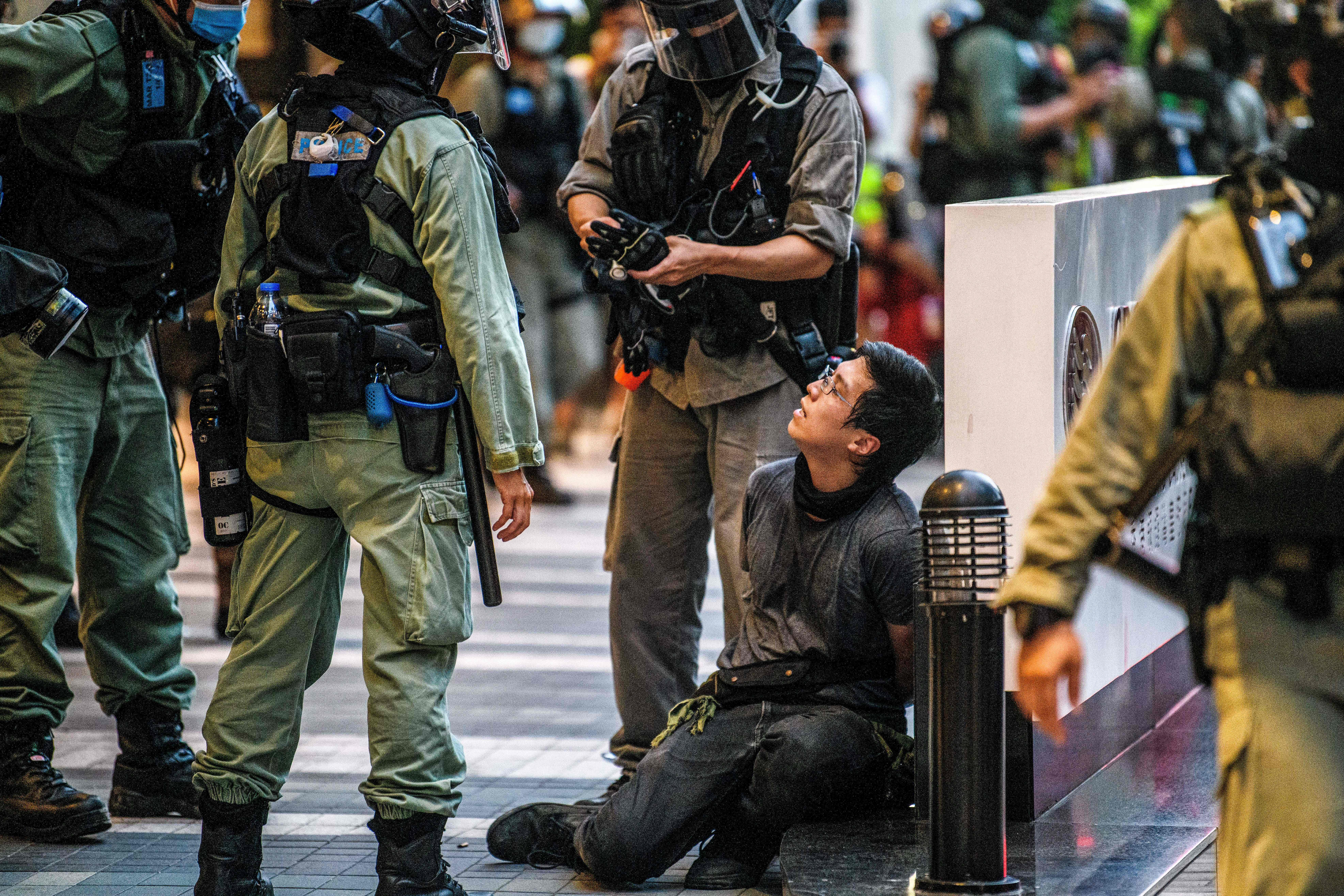 A protester is detained by police during a rally against a new national security law in Hong Kong on July 1, 2020. (Photo: Anthony Wallace/AFP via Getty Images)