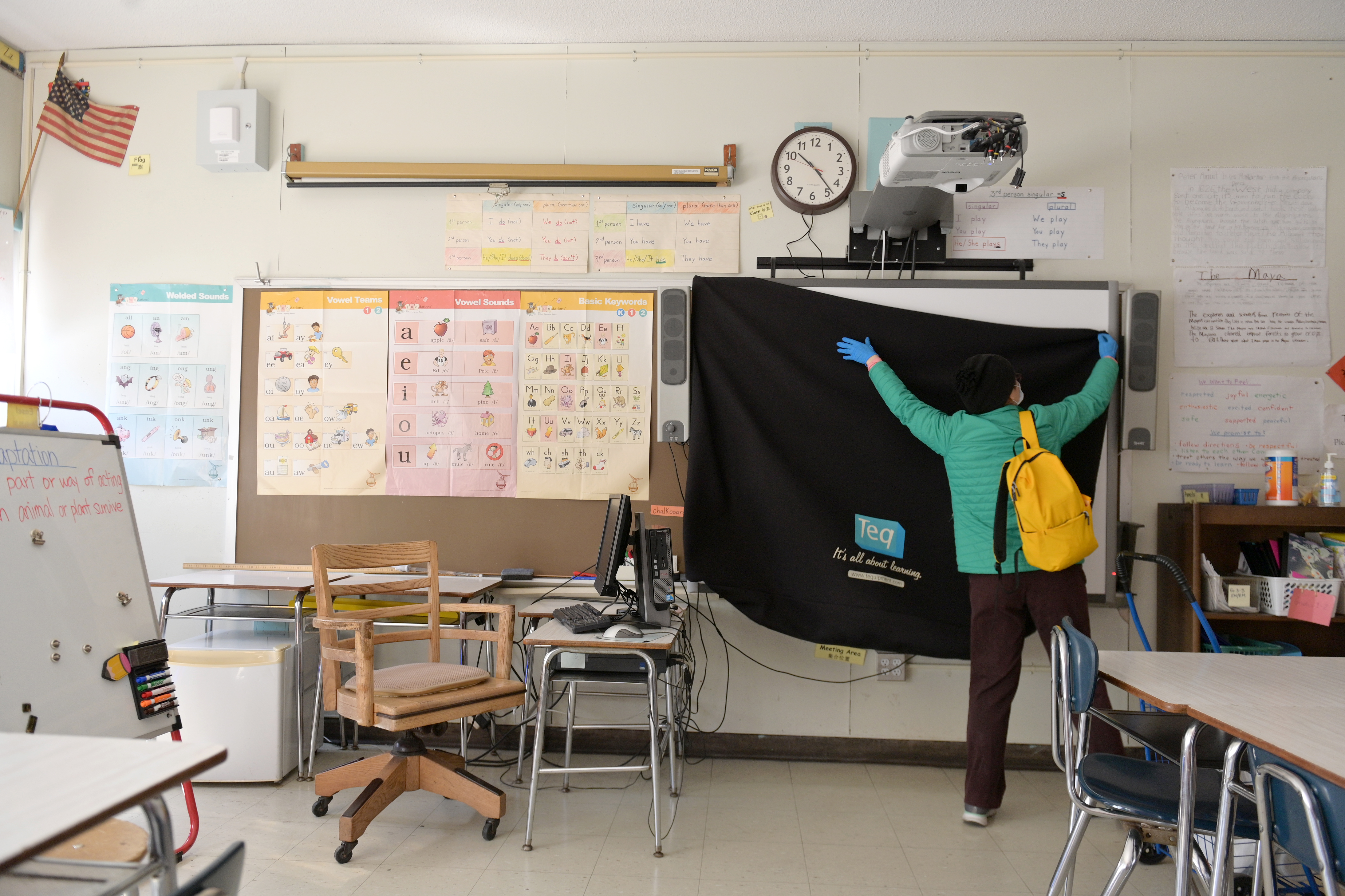 NEW YORK, NEW YORK - MAY 14: A teacher collects supplies needed to continue remote teaching through the end of the school year at Yung Wing School P.S. 124 on May 14, 2020 in New York City. (Photo by Michael Loccisano/Getty Images)