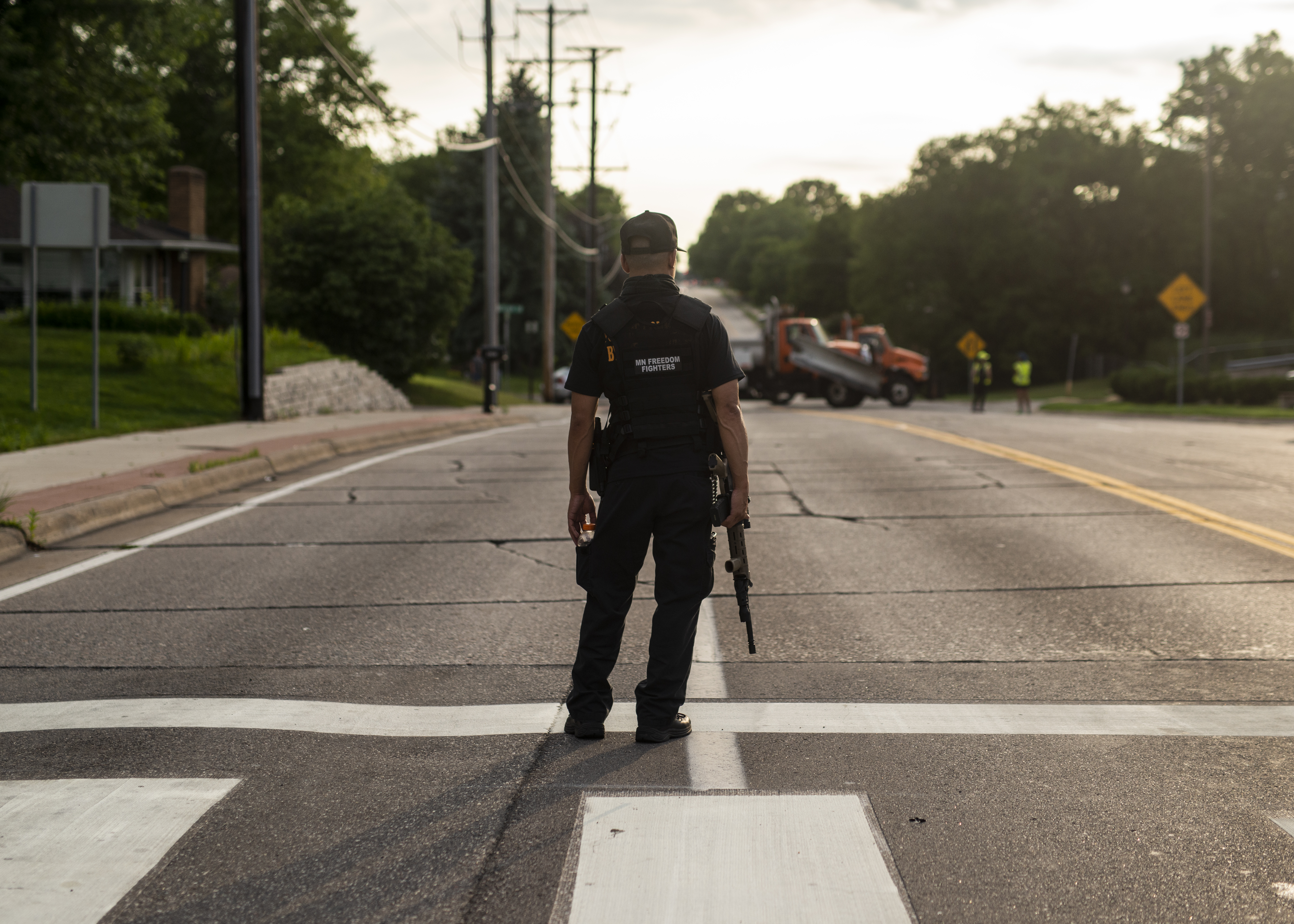 A member of the Minnesota Freedom Fighters stands guard on July 6, 2020. (Photo: Stephen Maturen/Getty Images)