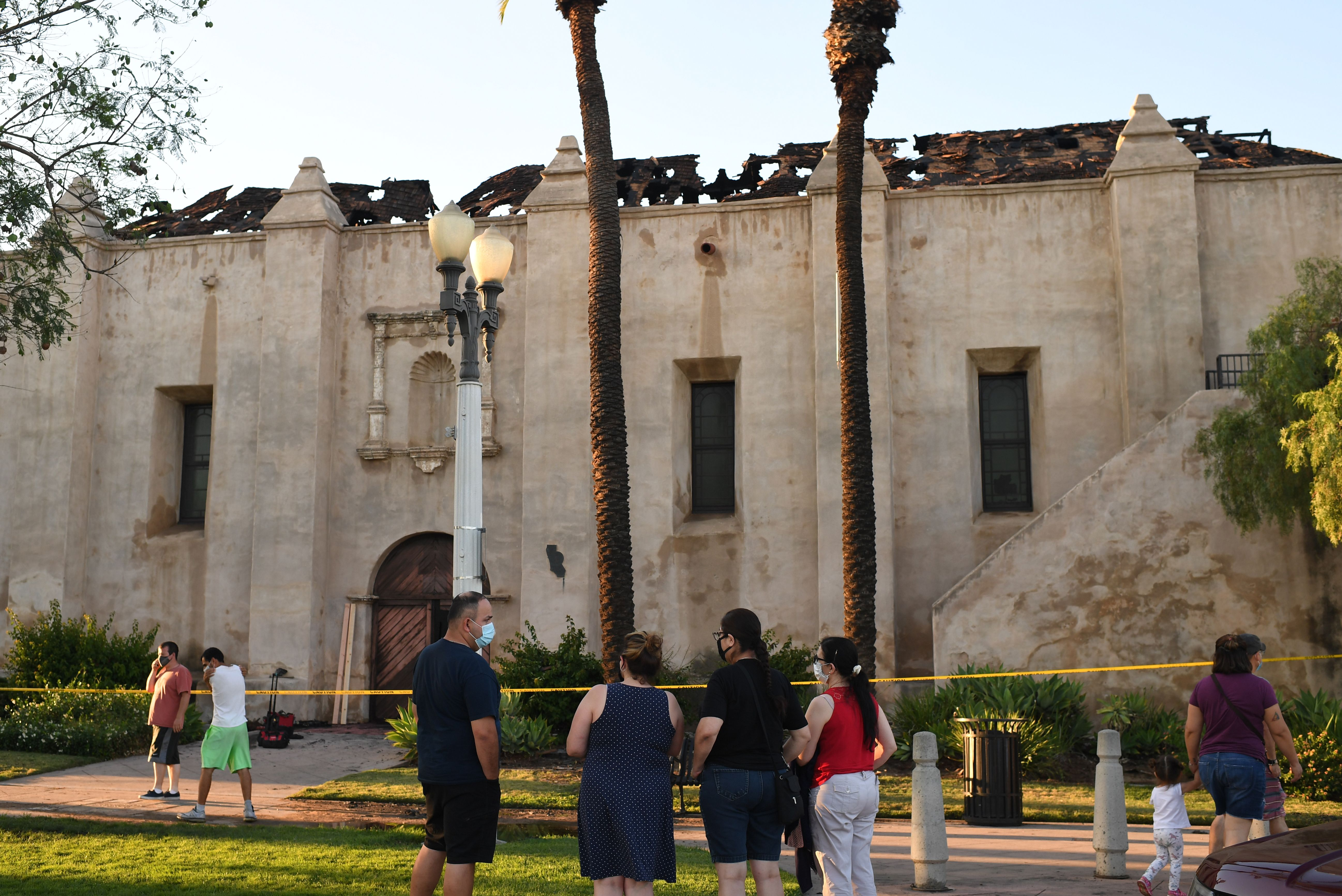 The damaged roof of the San Gabriel Mission is seen after a fire broke out early on July 11, 2020, in San Gabriel, California. (Photo by ROBYN BECK/AFP via Getty Images)