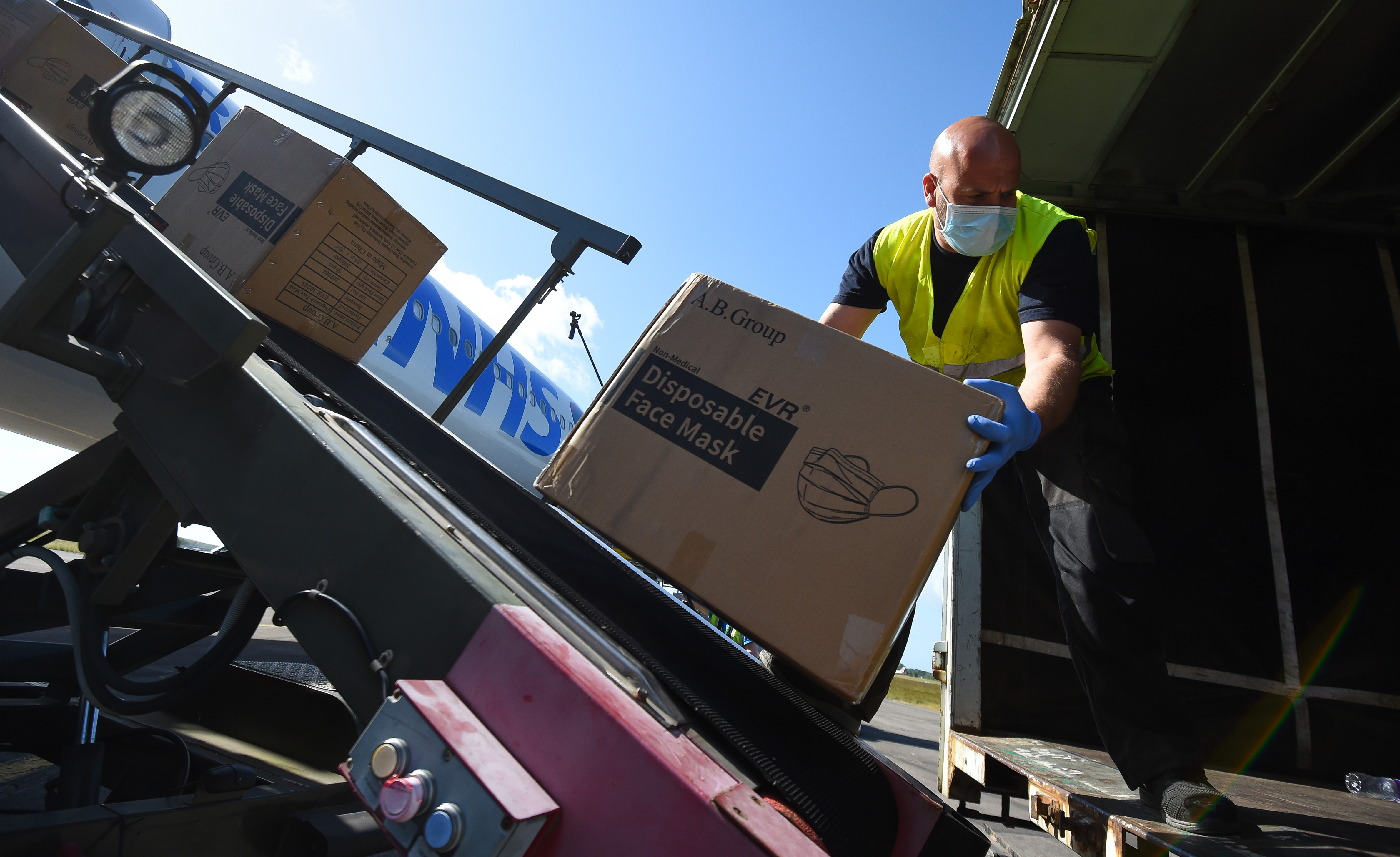 MAY 23: Boxes containing face masks are unloaded from a plane on May 23, 2020 in Bournemouth, England. The Airbus A340, owned by European Aviation Group, arrived at Bournemouth Airport from Tianjin loaded with 4 million masks.European Aviation Group's Chairman, Paul Stoddart, said: