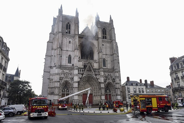 Firefighters are at work to put out a fire at the Saint-Pierre-et-Saint-Paul cathedral in Nantes, western France, on July 18, 2020. - A blaze that broke inside the gothic cathedral of Nantes on July 18 has been contained, emergency officials said, adding that the damage was not comparable to last year's fire at Notre-Dame cathedral in Paris. (Photo by SEBASTIEN SALOM-GOMIS/AFP via Getty Images)