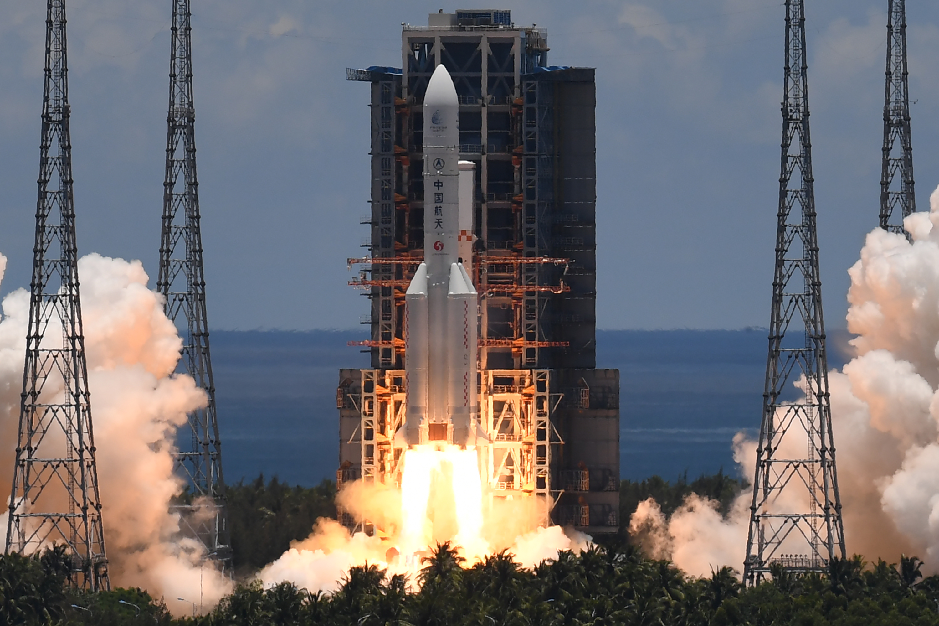 A Long March-5 rocket, carrying an orbiter, lander and rover as part of the Tianwen-1 mission to Mars, lifts off from the Wenchang Space Launch Centre in southern China's Hainan Province on July 23, 2020. (Photo: Noel Celis/AFP via Getty Images)