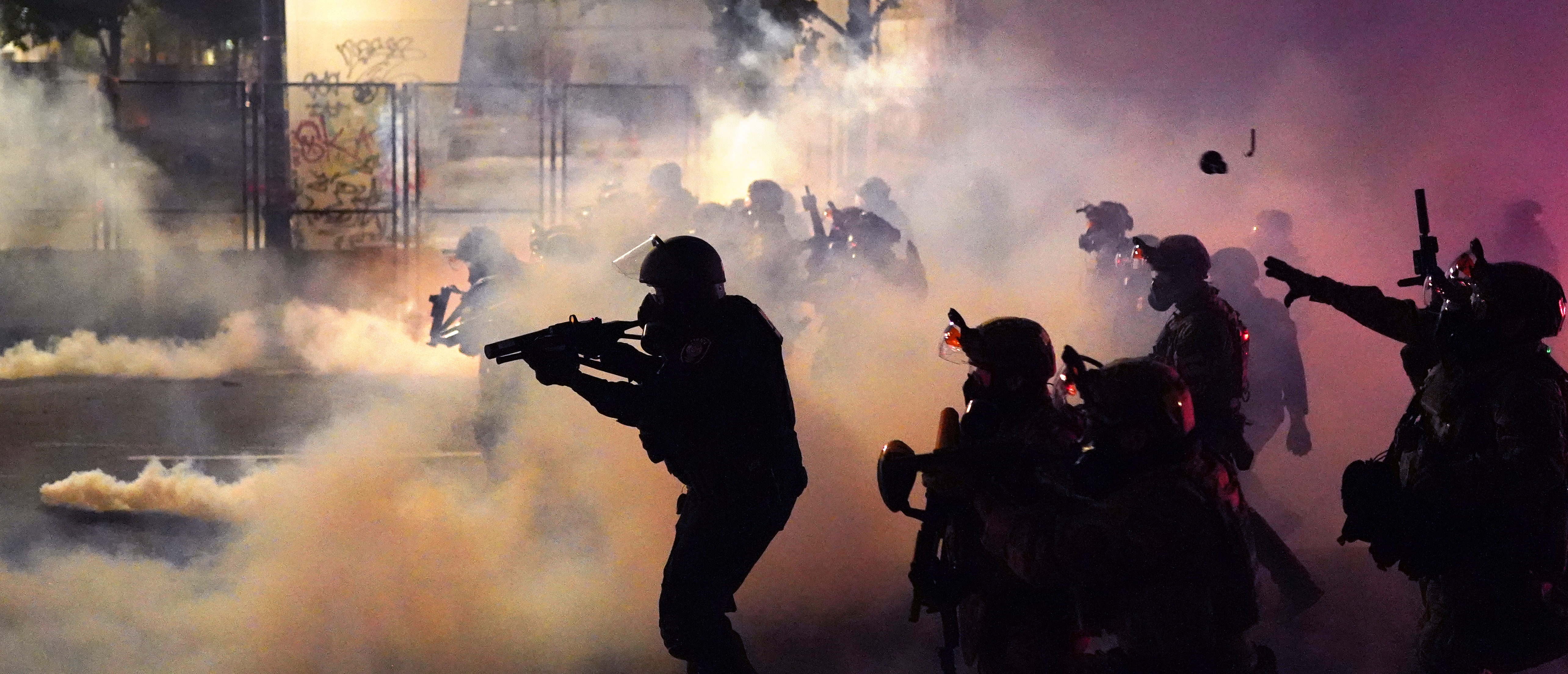 PORTLAND, OR - JULY 24: Federal officers deploy tear gas and less-lethal munitions while dispersing a crowd of about a thousand protesters in front of the Mark O. Hatfield U.S. Courthouse on Thursday, July 24, 2020 in Portland, Oregon. Protesters continued to clash with federal officers Friday morning as President Trump announced plans to deploy similar federal forces to other U.S. cities. (Photo by Nathan Howard/Getty Images)