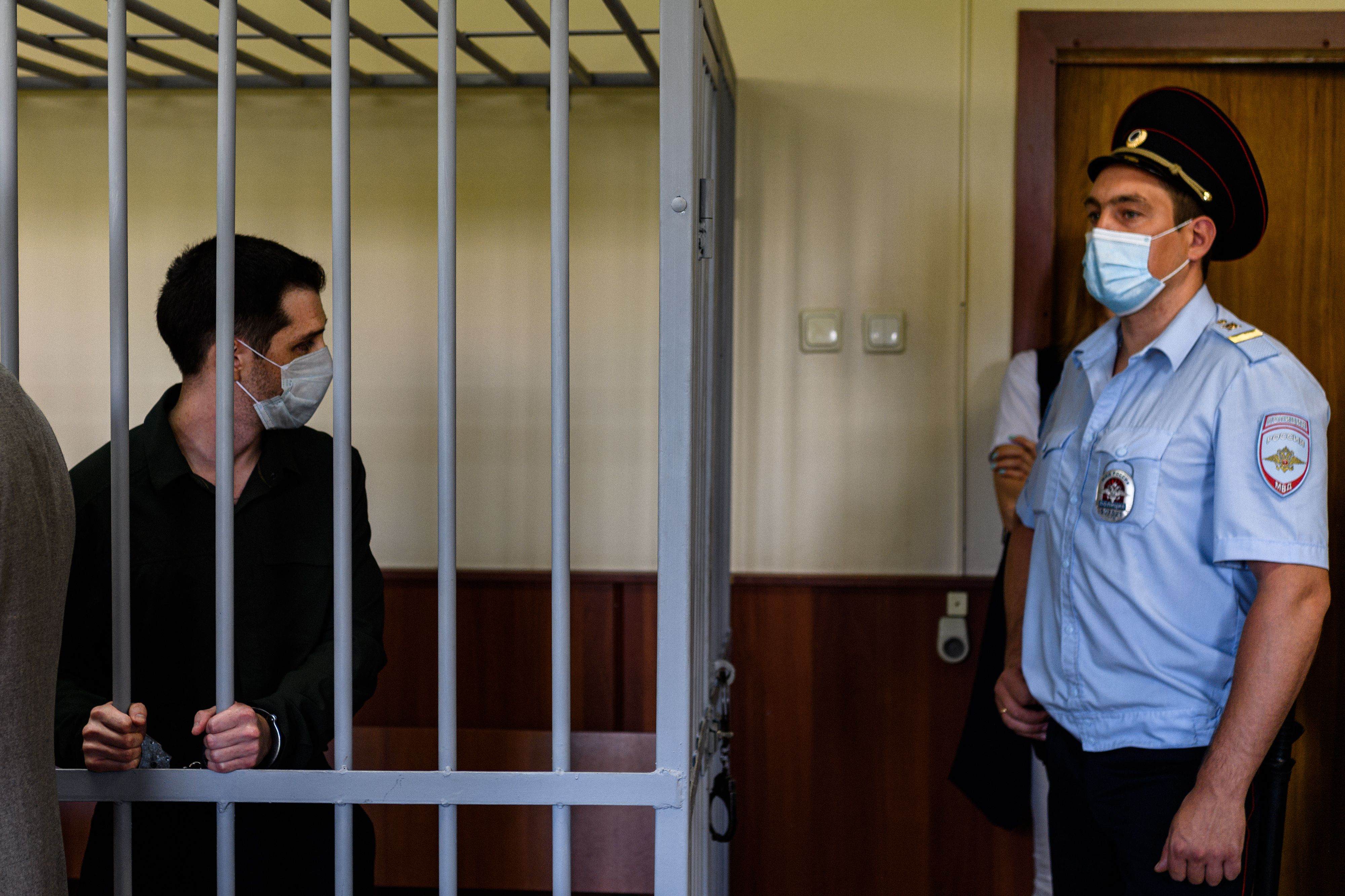 Trevor Reed stands inside a defendants' cage during his verdict hearing at a Moscow court on July 30, 2020. (Dimitar Dilkoff/AFP via Getty Images)