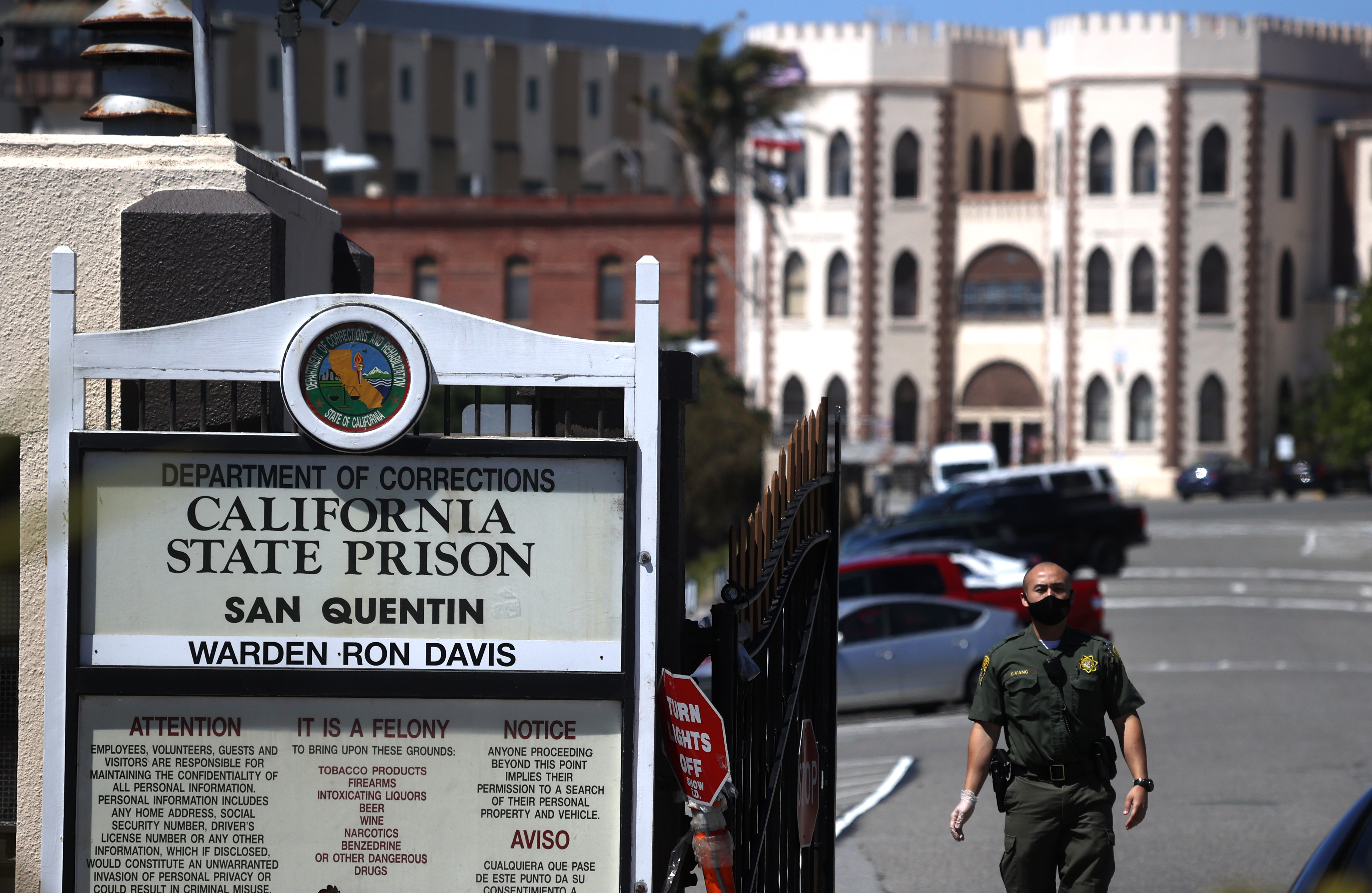 A California Department of Corrections and Rehabilitation (CDCR) officer wears a protective mask as he stands guard at the front gate of San Quentin State Prison on June 29, 2020 in San Quentin, California. (Justin Sullivan/Getty Images)