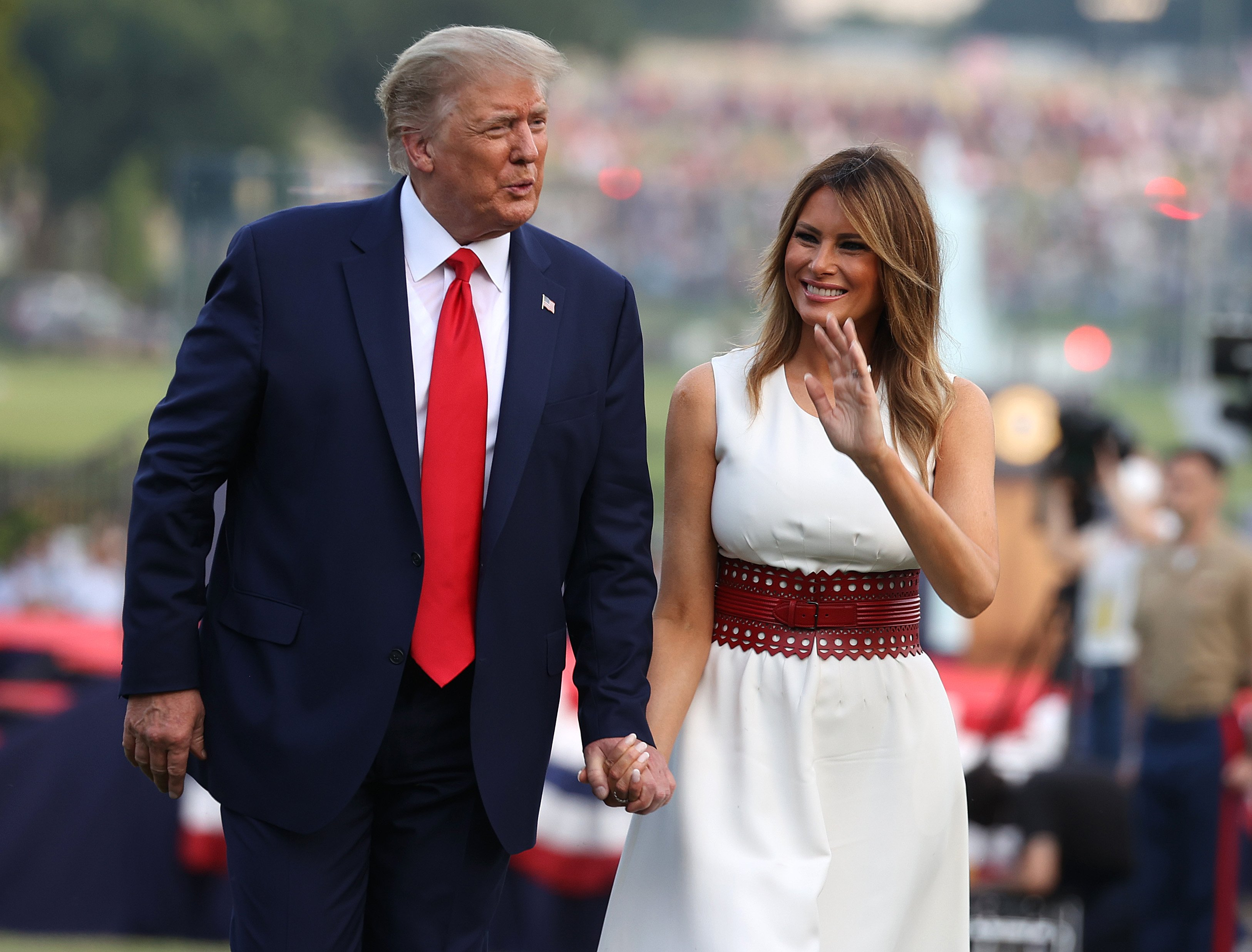 "WASHINGTON, DC - JULY 04: President Donald Trump and first Lady Melania Trump walk along the South Lawn during an event at the White House on July 04, 2020 in Washington, DC. President Trump is hosting a ""Salute to America"" celebration that includes flyovers by military aircraft and a large fireworks display. (Photo by Tasos Katopodis/Getty Images)"