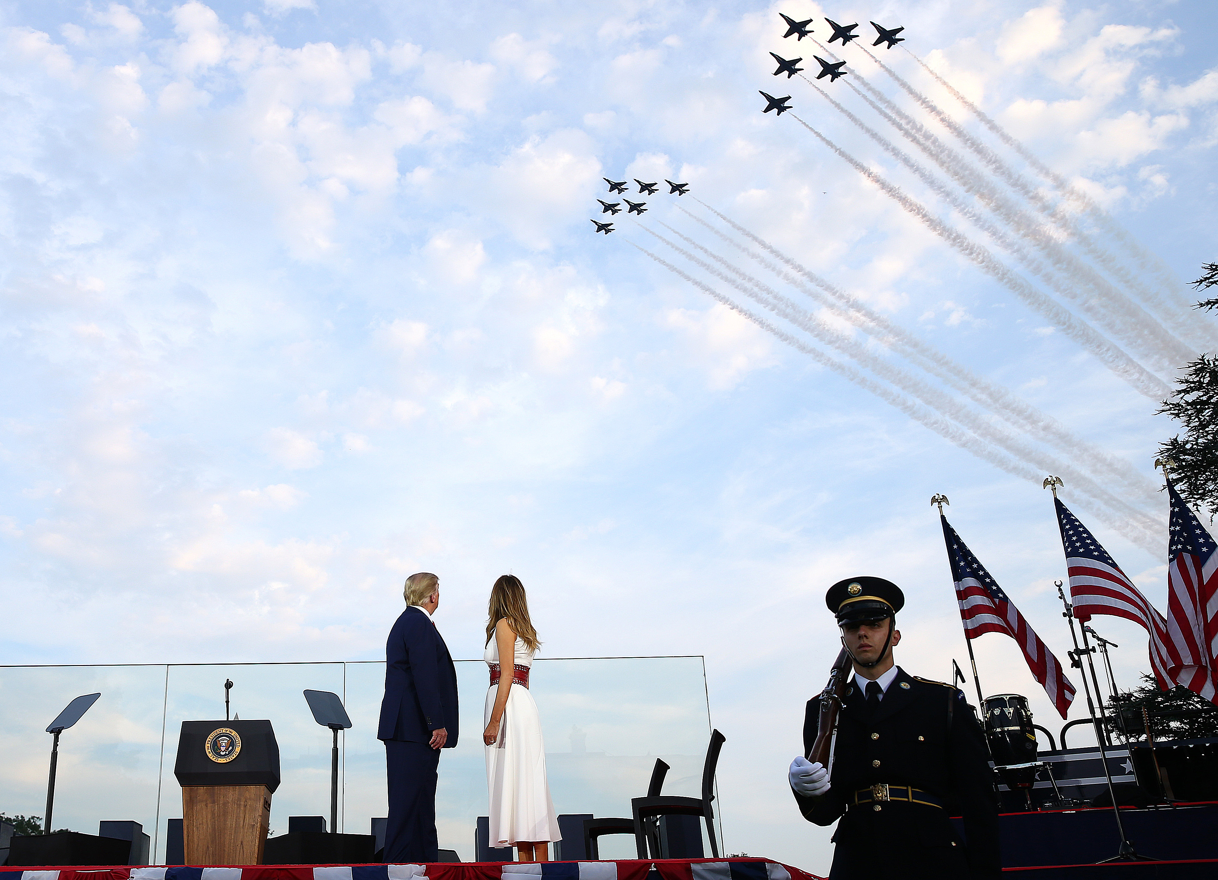 "WASHINGTON, DC - JULY 04: U.S. President Donald Trump and first lady Melania Trump watch the U.S. Navy Blue Angels and U.S. Air Force Thunderbirds perform a flyover near the White House on July 04, 2020 in Washington, DC. U.S. President Donald Trump is hosting a ""Salute to America"" celebration that includes flyovers by military aircraft and a large fireworks display. (Photo by Tasos Katopodis/Getty Images)"