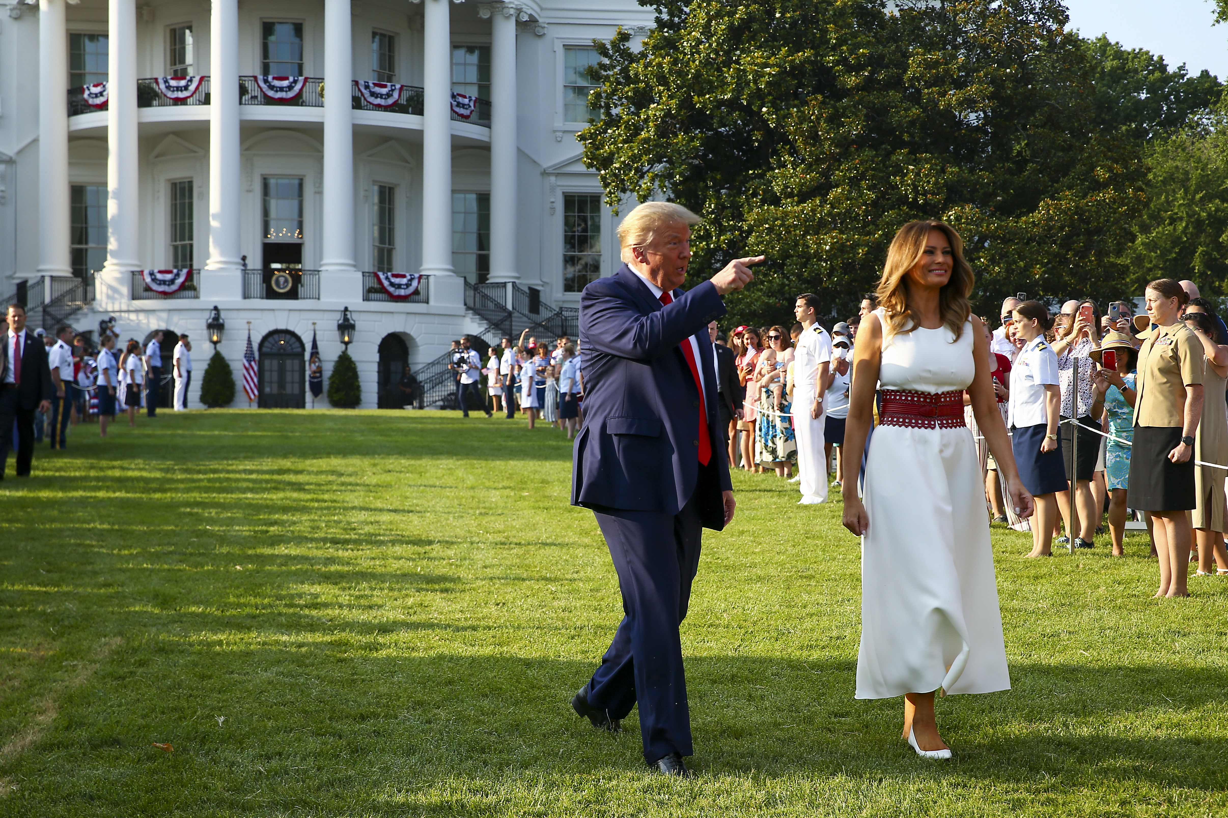 """WASHINGTON, DC - JULY 04: President Donald Trump and first Lady Melania Trump walk out to an event on the South Lawn of the White House on July 04, 2020 in Washington, DC. President Trump is hosting a """"Salute to America"""" celebration that includes flyovers by military aircraft and a large fireworks display. (Photo by Tasos Katopodis/Getty Images)"""