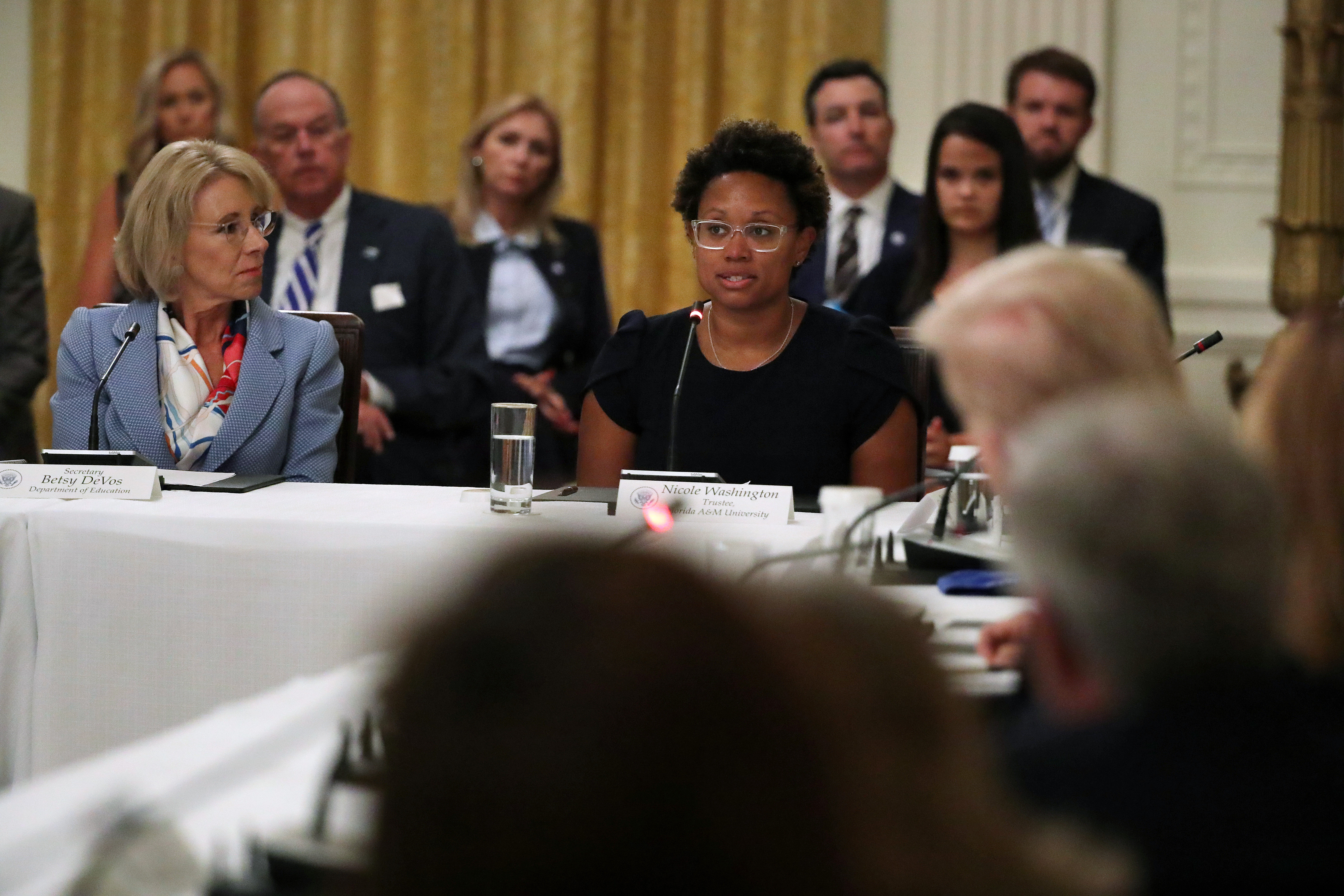 WASHINGTON, DC - JULY 07: Education Secretary Betsy DeVos (L) and Nicole Washington, Trustee, Florida A&M University Trustee Nicole Washington participate in a meeting hosted by U.S. President Donald Trump about how to safely re-open schools during the novel coronavirus pandemic in the East Room at the White House July 07, 2020 in Washington, DC. As the number of COVID-19 cases surge across southern states like Florida, Texas, Louisiana, South Carolina and Arizona, Trump joined with guests from across the country to discuss how to responsibly return to the classroom. (Photo by Chip Somodevilla/Getty Images)