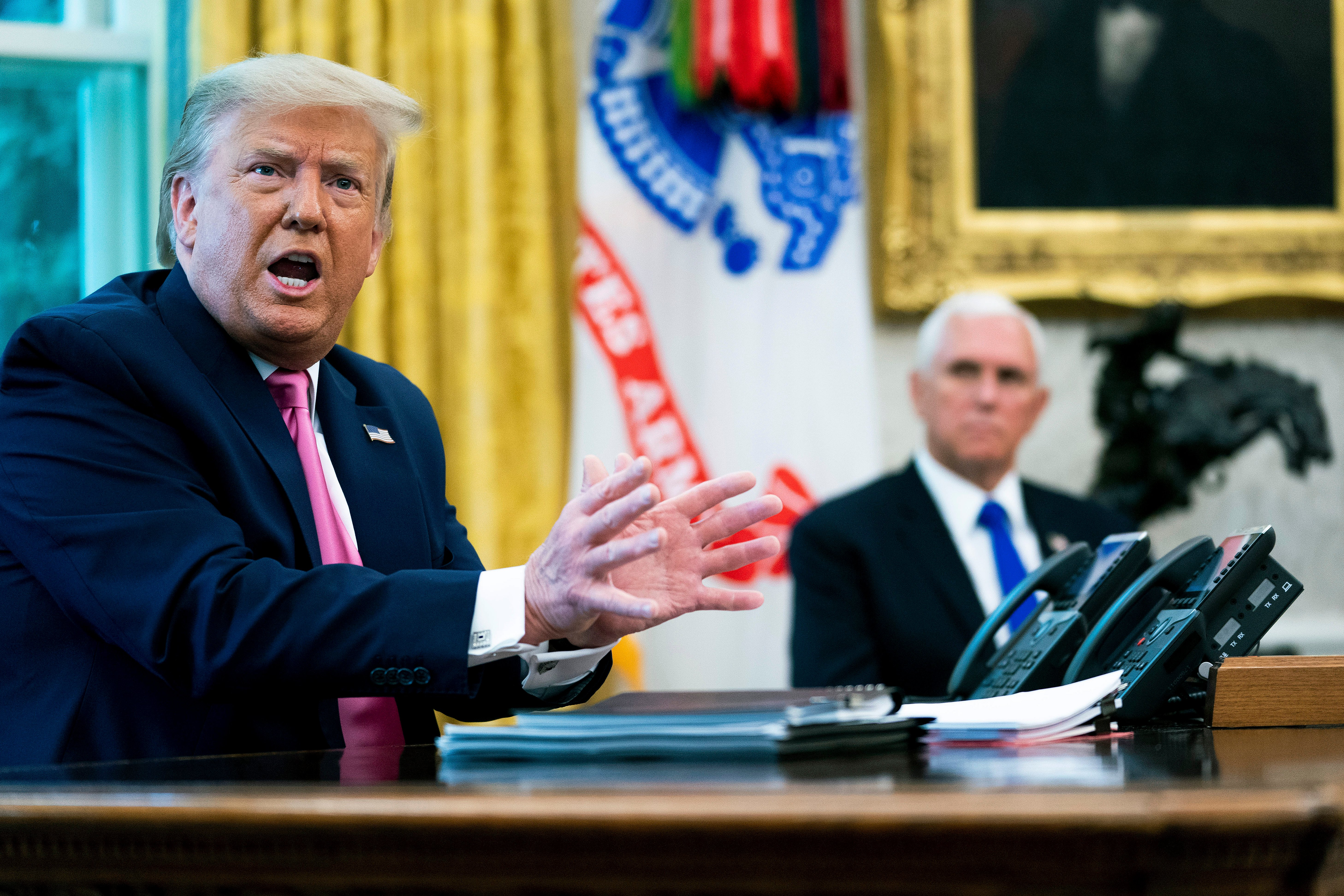WASHINGTON, DC - JULY 20: U.S. President Donald Trump talks to reporters with Vice President Mike Pence in the Oval Office at the White House July 20, 2020 in Washington, DC. Trump hosted Republican Congressional leaders and members of his cabinet to talk about a proposed new round of financial stimulus to help the economy during the ongoing global coronavirus pandemic. (Photo by Doug Mills-Pool/Getty Images)