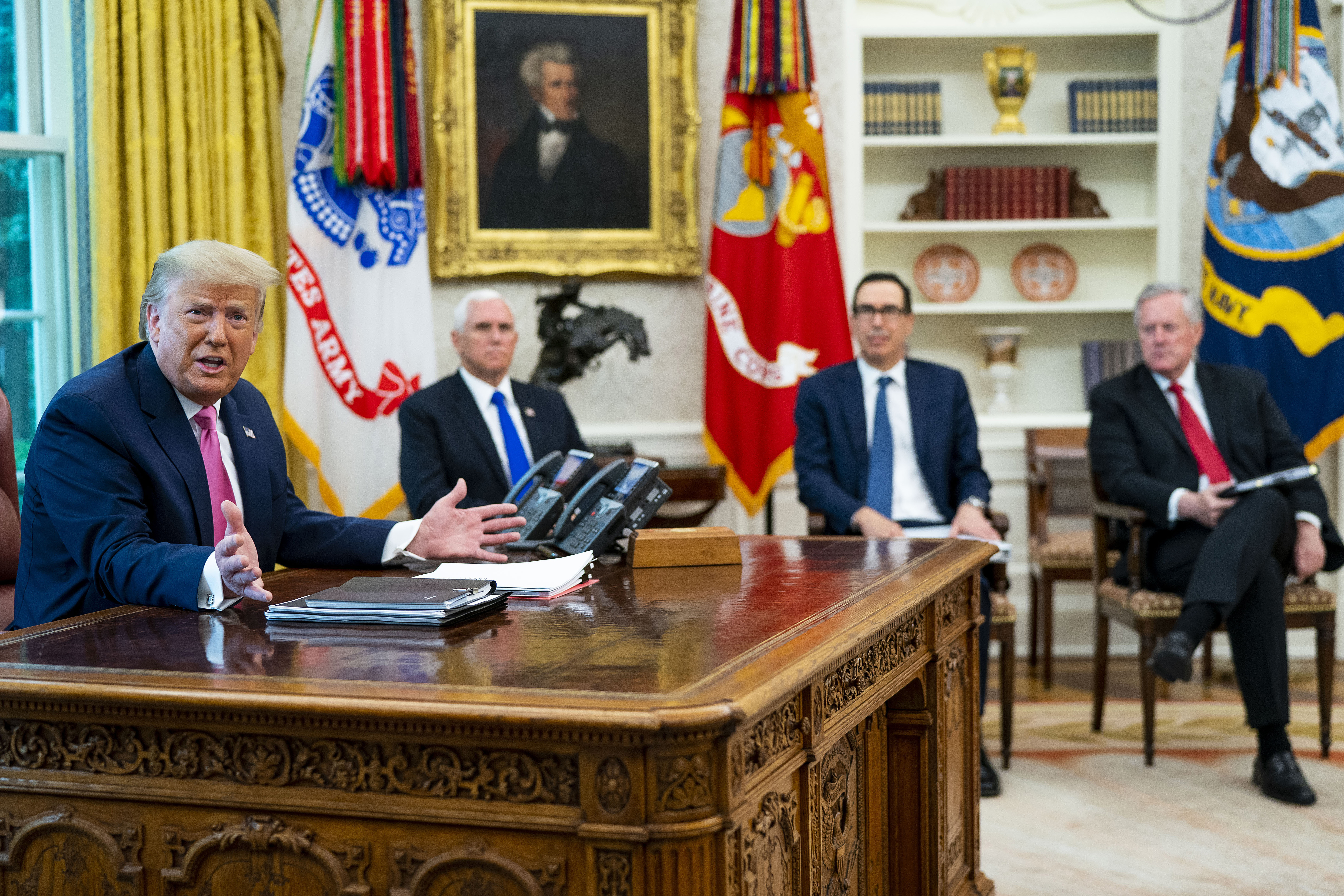 WASHINGTON, DC - JULY 20: U.S. President Donald Trump talks to reporters while hosting (2nd L-R) Vice President Mike Pence, Treasury Secretary Steven Mnuchin, White House Chief of Staff Mark Meadows and Republican congressional leaders in the Oval Office at the White House July 20, 2020 in Washington, DC. Trump and the congressional leaders talked about a proposed new round of financial stimulus to help the economy during the ongoing global coronavirus pandemic. (Photo by Doug Mills-Pool/Getty Images)