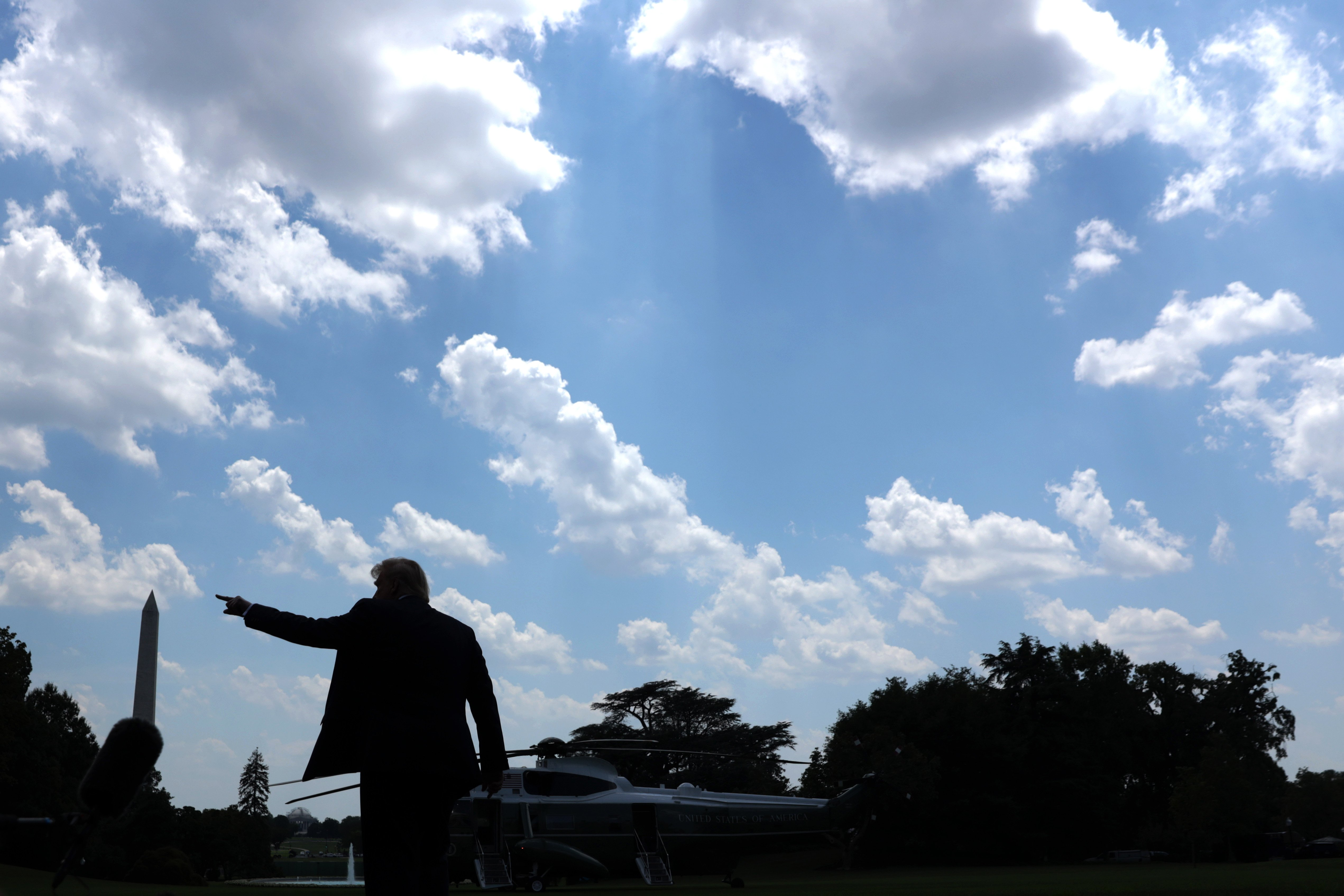 "WASHINGTON, DC - JULY 27: U.S. President Donald Trump gestures prior to his departure from the White House July 27, 2020 in Washington, DC. President Trump is scheduled to visit the FUJIFILM Diosynth Biotechnologies' Innovation Center in Morrisville, North Carolina, a facility that supports manufacturing of ""key components of the COVID-19 vaccine candidate"" developed by Novavax. (Photo by Alex Wong/Getty Images)"