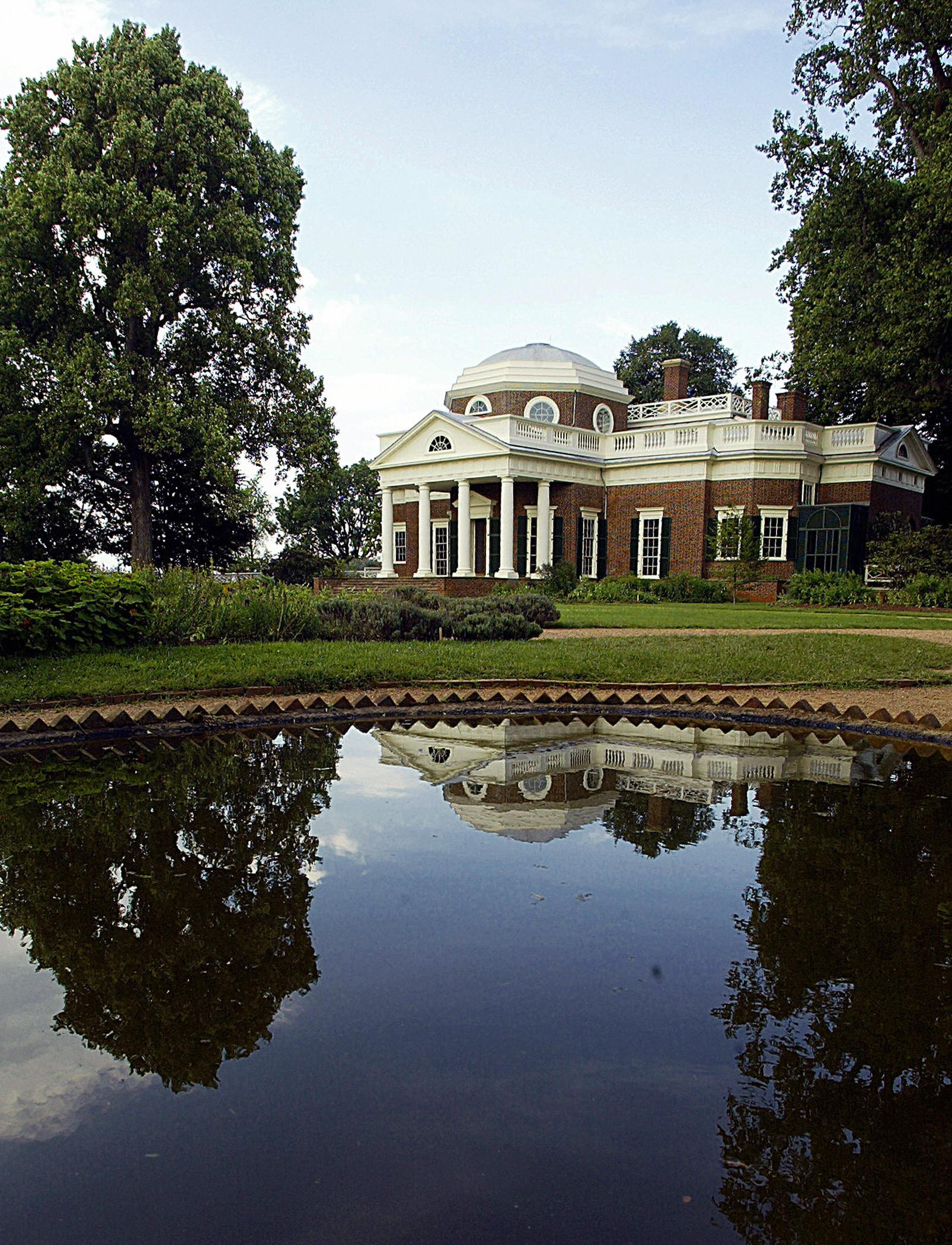 A pond used to store live fish to eat reflects the home of third US President Thomas Jefferson, author of the Declaration of Independence, 12 July, 2003, in Monticello, Virginia. (Paul J. Richards/AFP via Getty Images)