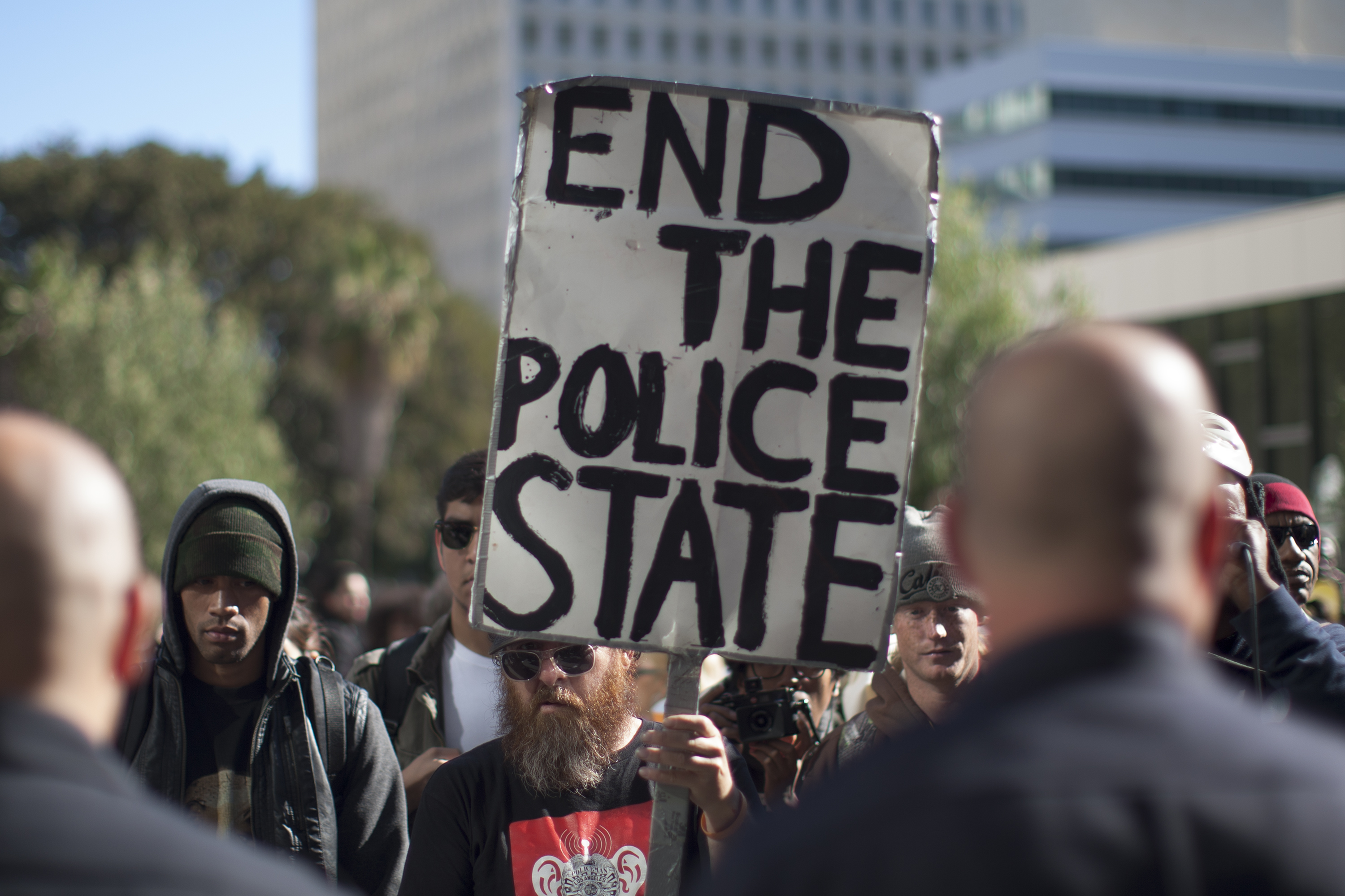 Protesters and police face off during a rally at Los Angeles Police Department Headquarters against the fatal police shooting of an unarmed homeless man on March 3, 2015. (Photo: David McNew/Getty Images)