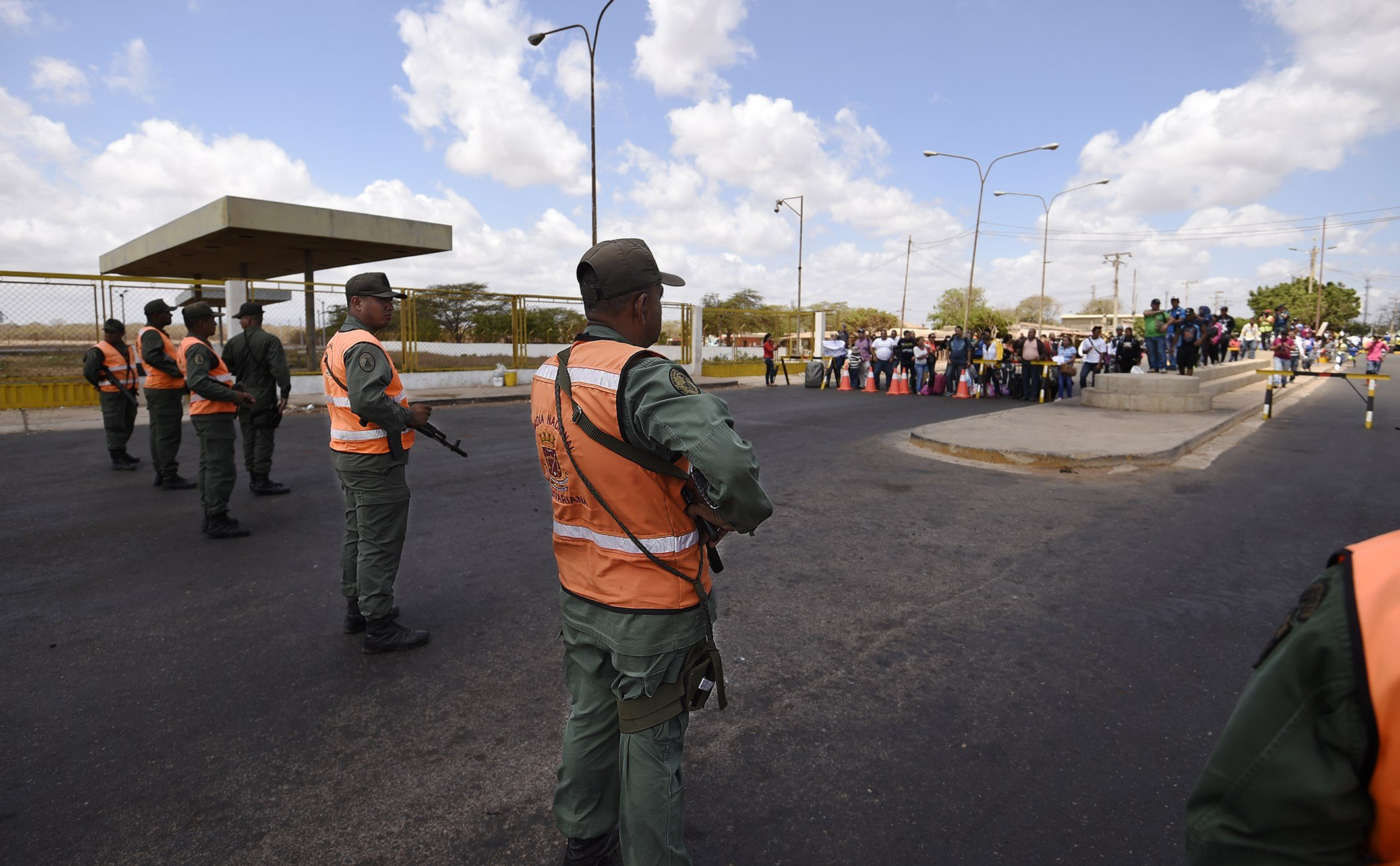 Members of the national guard stand at a checkpoint in Paraguachon, Zulia state, Venezuela, in the border with Colombia on Sept. 9, 2015. Venezuela's President Nicolas Maduro late Monday said he had ordered more of his country's vast border with Colombia closed amid a diplomatic crisis over deportations and smuggling. (JUAN BARRETO/AFP via Getty Images)
