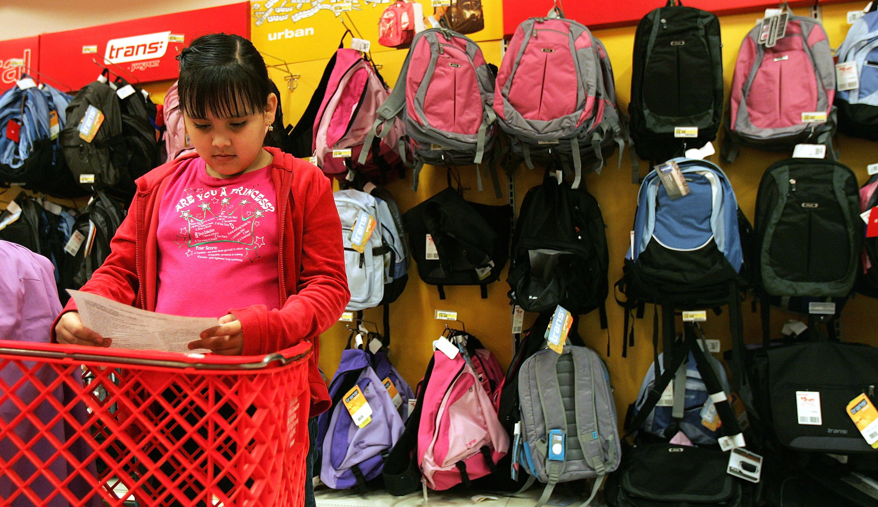 atricia Zaragoza, 9, checks her back-to-school shopping list at a Target store August 11, 2005 in Rosemont, Illinois. (Photo by Tim Boyle/Getty Images)