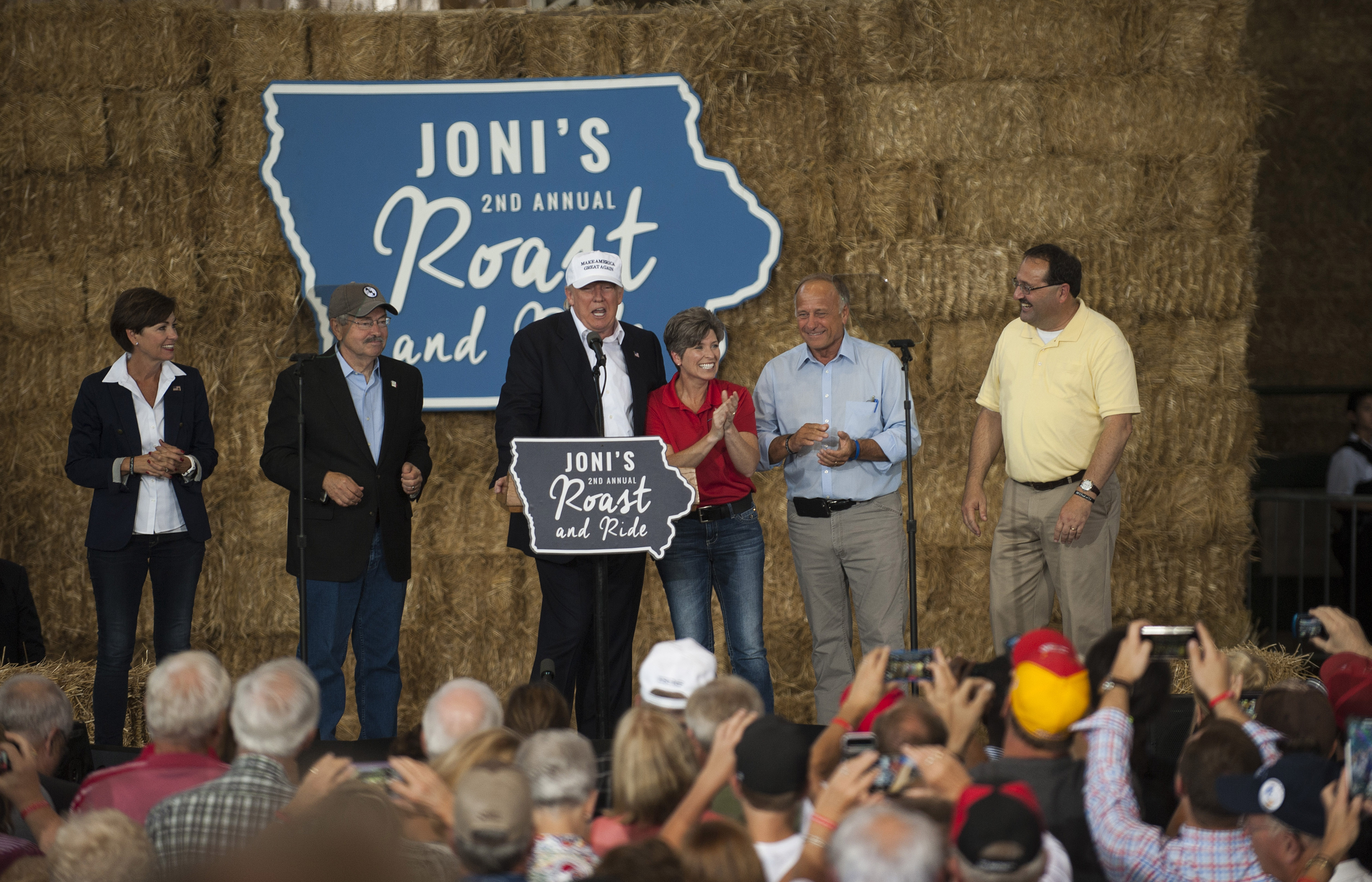Kim Reynolds, Lieutenant Governor (R-IA), Left, Terry Branstad, Governor (R-IA), Republican presidential nominee Donald Trump, Sen. Joni Ernst (R-IA), Jeff Kaufmann, Republican Party of Iowa Chairman, and Rep. Steve King (R-IA) on stage at the 2nd annual Joni Ernst Roast and Ride event on August 27, 2016 in Des Moines, Iowa. (Stephen Maturen/Getty Images)