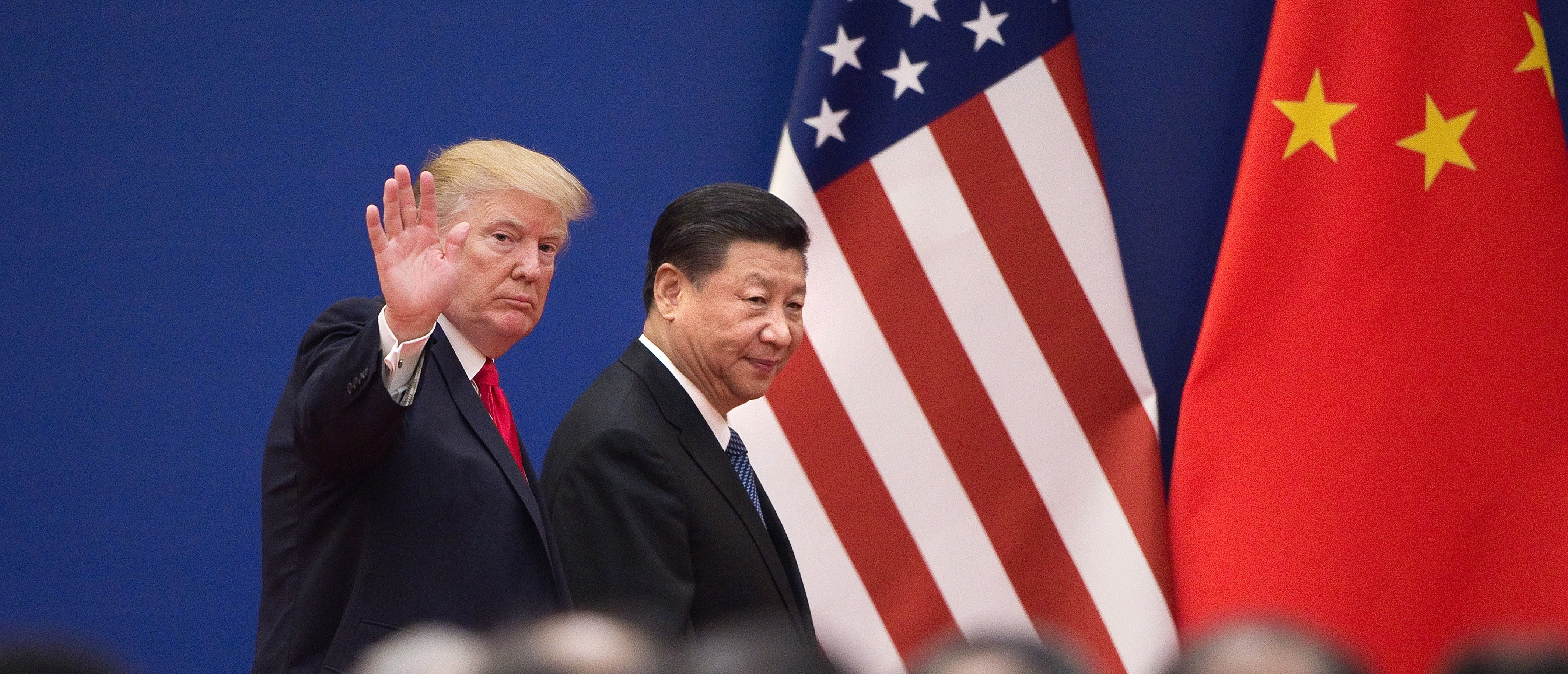 """TOPSHOT - US President Donald Trump (L) and China's President Xi Jinping leave a business leaders event at the Great Hall of the People in Beijing on November 9, 2017. Donald Trump urged Chinese leader Xi Jinping to work """"hard"""" and act fast to help resolve the North Korean nuclear crisis, during their meeting in Beijing on November 9, warning that """"time is quickly running out"""". / AFP PHOTO / Nicolas ASFOURI (Photo credit should read NICOLAS ASFOURI/AFP via Getty Images)"""