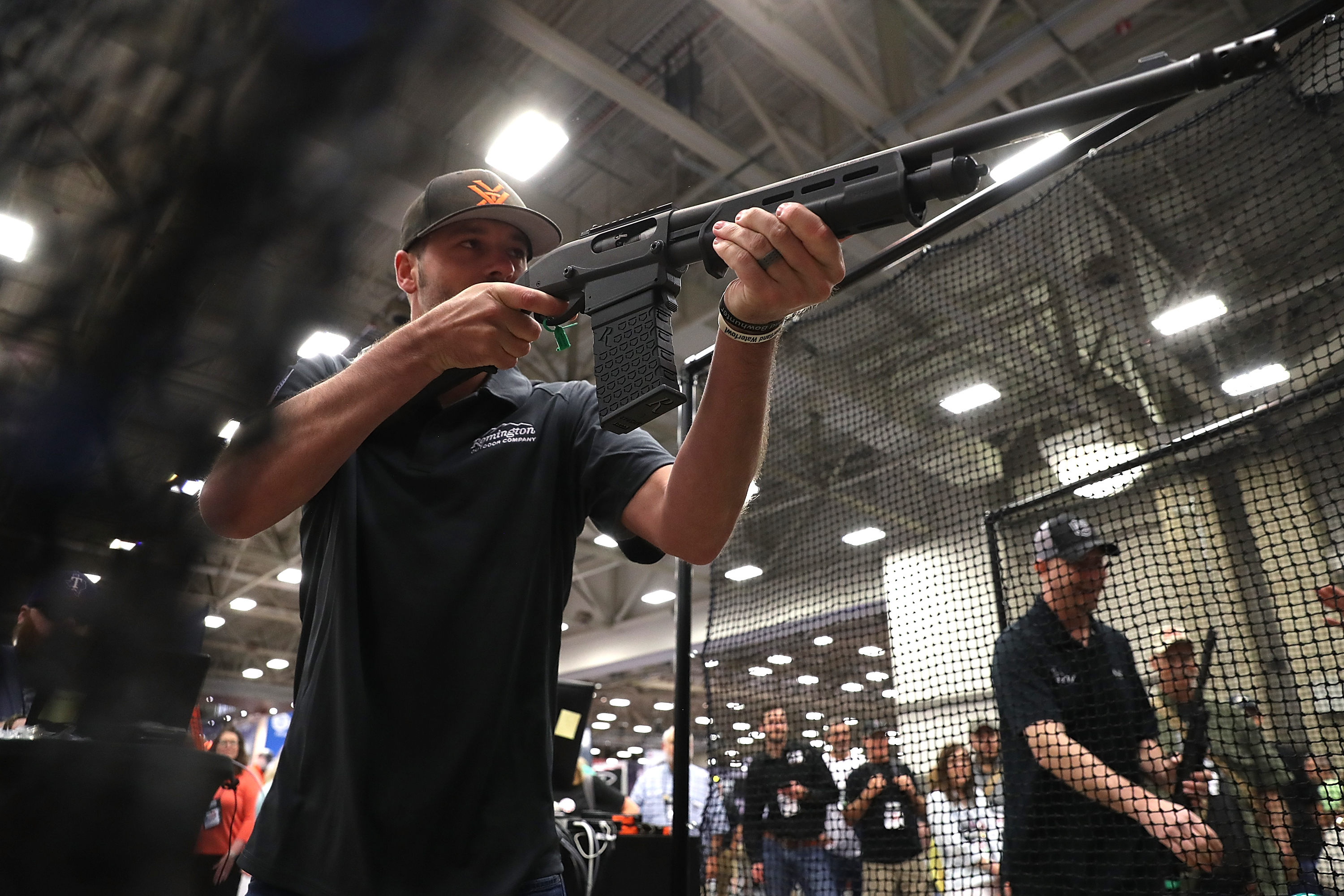 DALLAS, TX - MAY 05: An attendee participates in a gun reloading competition at the Remington booth during the NRA Annual Meeting & Exhibits at the Kay Bailey Hutchison Convention Center on May 5, 2018 in Dallas, Texas. The National Rifle Association's annual meeting and exhibit runs through Sunday. (Justin Sullivan/Getty Images)