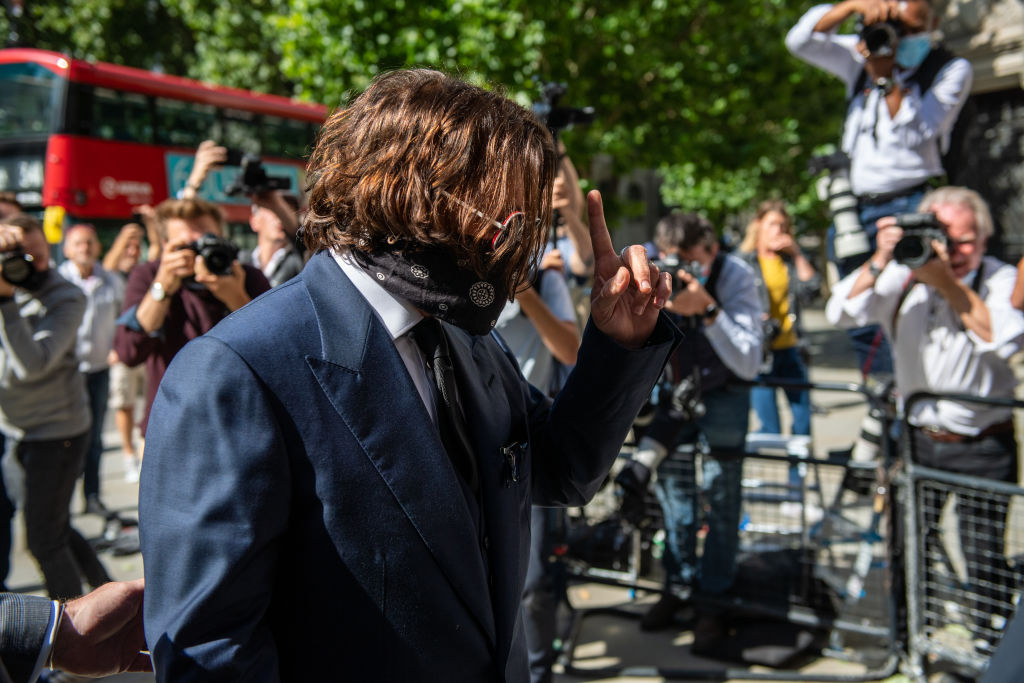 Johnny Depp arrives at The Royal Courts of Justice on the Strand on July 7, 2020 in London, England. Hollywood actor Johnny Depp is taking News Group Newspapers, publishers of The Sun, to court over allegations that he was violent towards his ex-wife, Amber Heard, 34. (Photo by Chris J Ratcliffe/Getty Images)