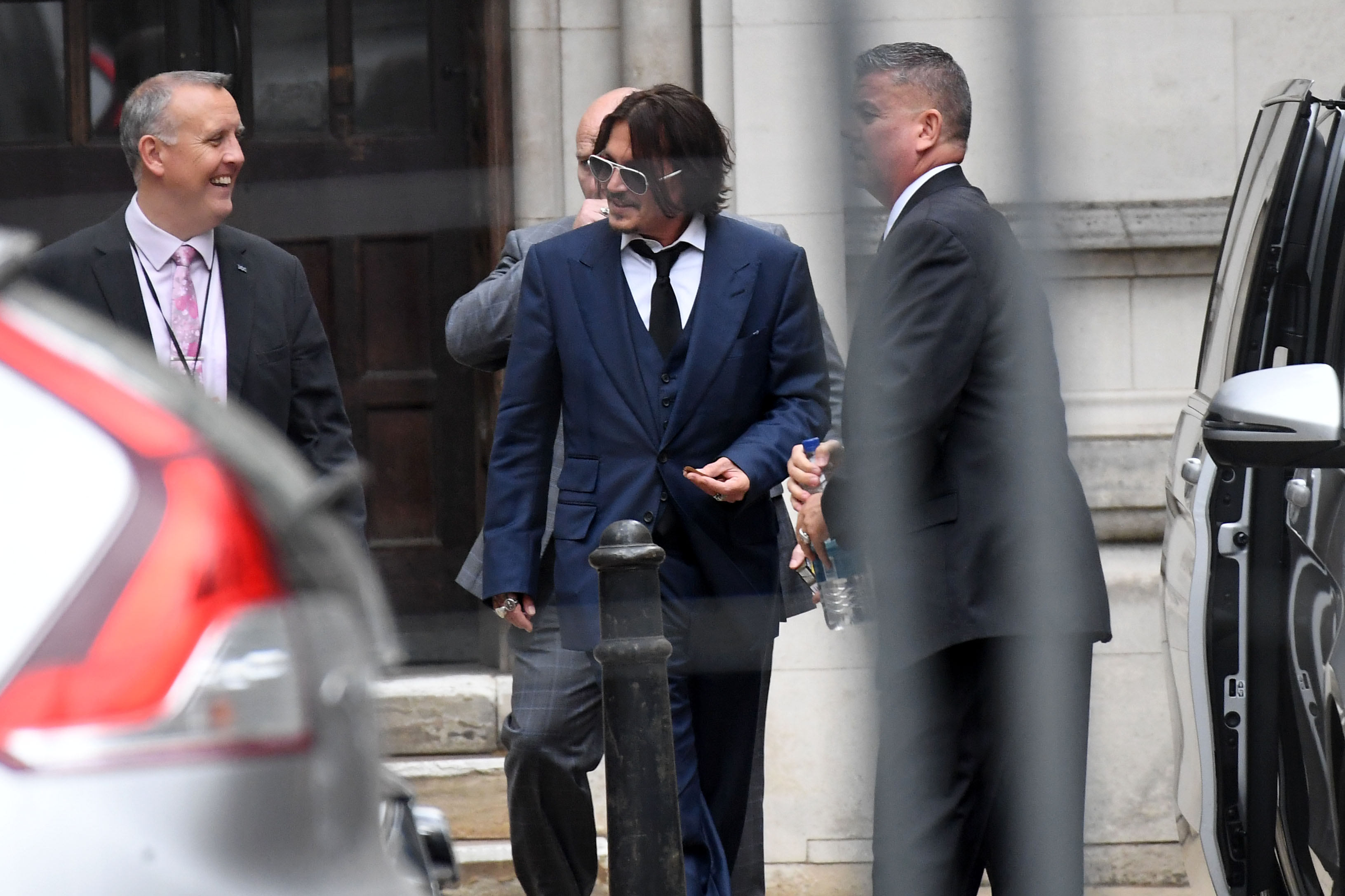 Johnny Depp leaves The Royal Courts of Justice, on the Strand on July 7, 2020 in London, England. Hollywood actor Johnny Depp is taking News Group Newspapers, publishers of The Sun, to court over allegations that he was violent towards his ex-wife, Amber Heard, 34. (Photo by Peter Summers/Getty Images)
