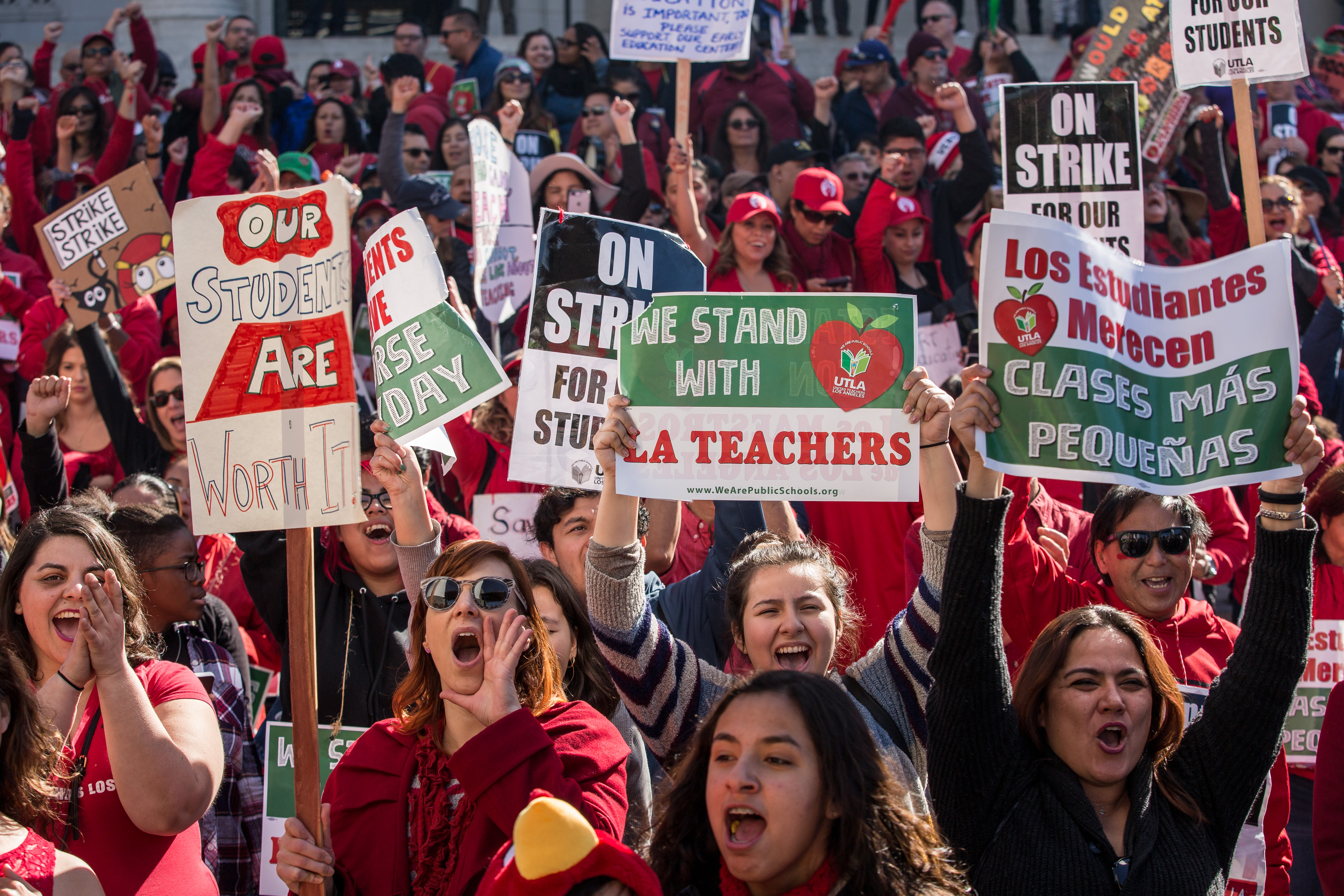 LOS ANGELES, CA - JANUARY 22: Educators, parents, students, and supporters of the Los Angeles teachers strike wave and cheer in Grand Park on January 22, 2019 in downtown Los Angeles, California.Thousands of striking teachers cheered for victory at the rally after it was announced that a tentative deal between the United Teachers of Los Angeles union and the Los Angeles Unified School District heavily favored educators' demands including a cap on rising class sizes, funding for school nurses, and a significant pay increase. (Photo by Scott Heins/Getty Images)