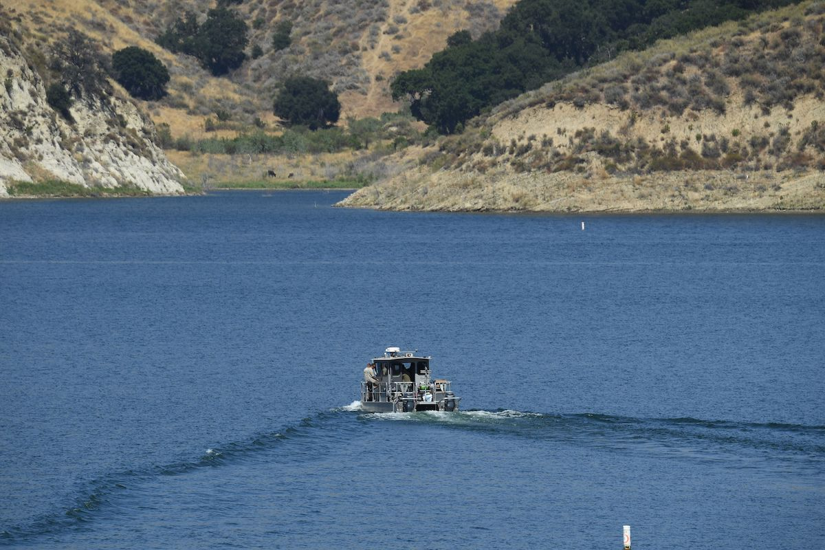 """A Los Angeles County Sheriff's Department boat is seen on Lake Piru as it aids in the effort to find actress Naya Rivera on July 10, 2020 in Piru near Fillmore, California. - """"Glee"""" star Rivera is missing and feared drowned at Lake Piru where patrol boats and helicopters resumed their search for the US actress. (Photo by ROBYN BECK/AFP via Getty Images)"""